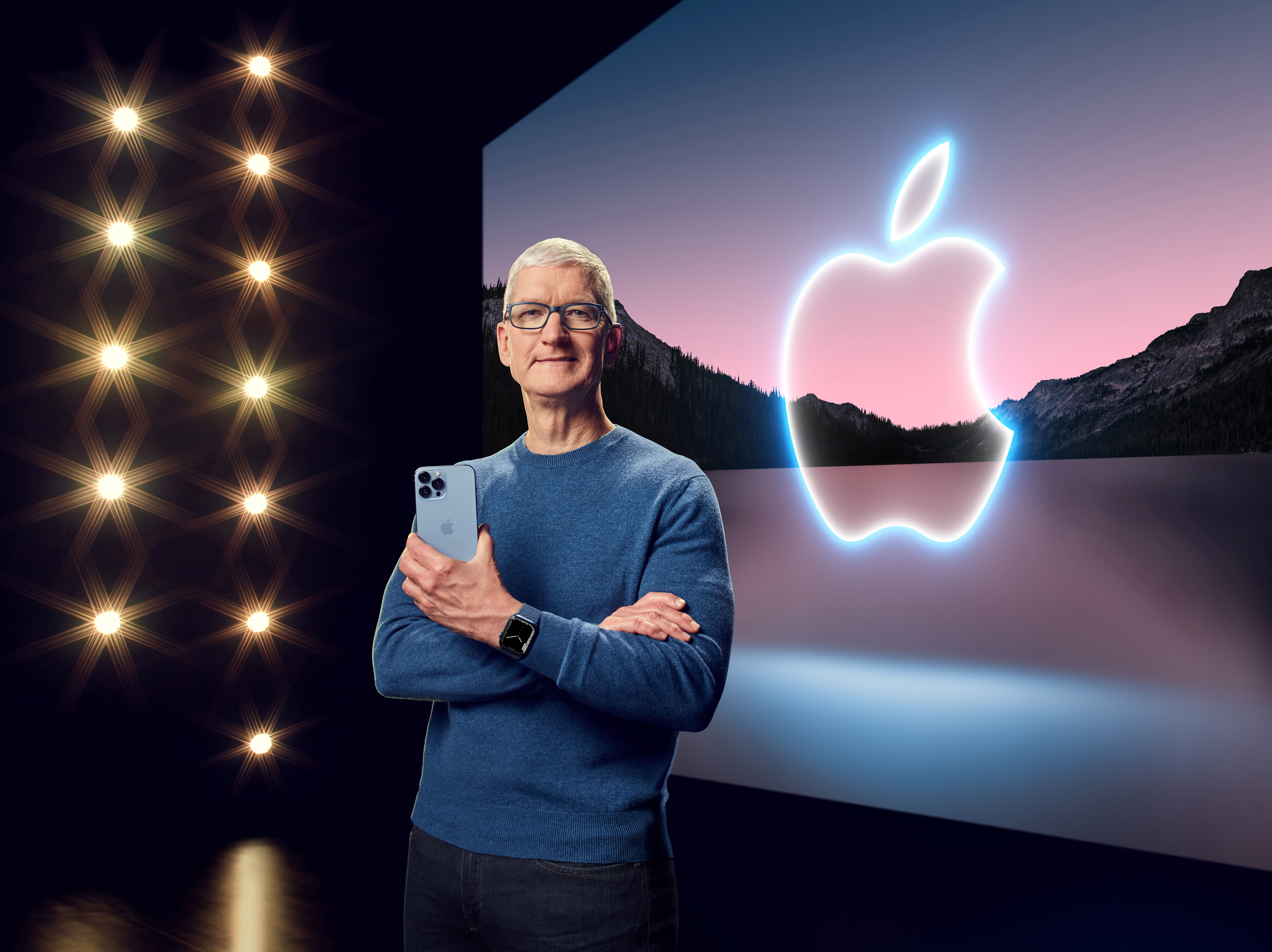 Apple CEO Tim Cook holds the iPhone 13 Pro Max and Apple Watch Series 7 during a special event at Apple Park in Cupertino, California broadcast September 14, 2021.  Apple Inc/Handout via REUTERS
