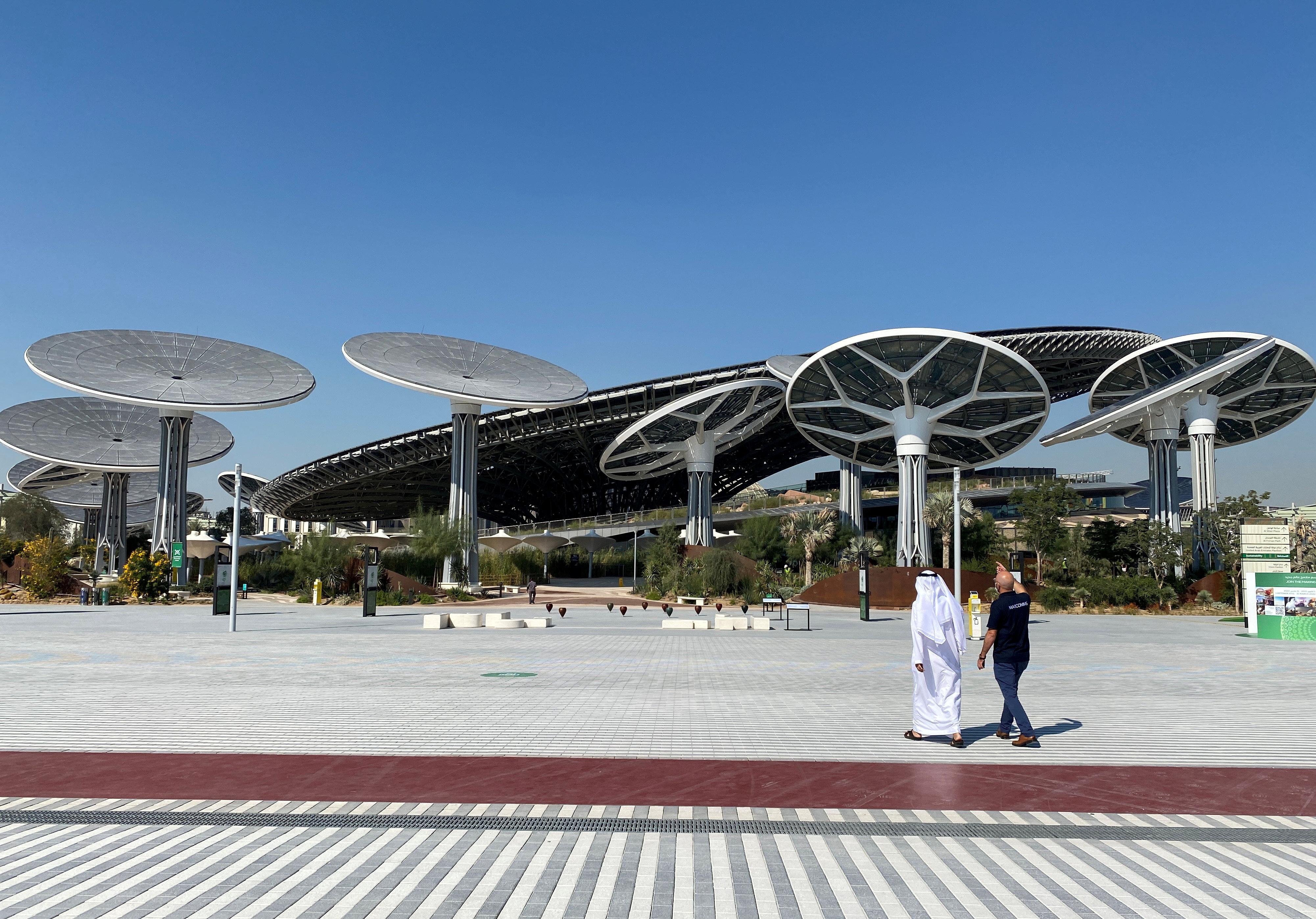 People walk at the site of Dubai Expo 2020 in Dubai, United Arab Emirates January 16, 2021. REUTERS/Rula Rouhana/File Photo