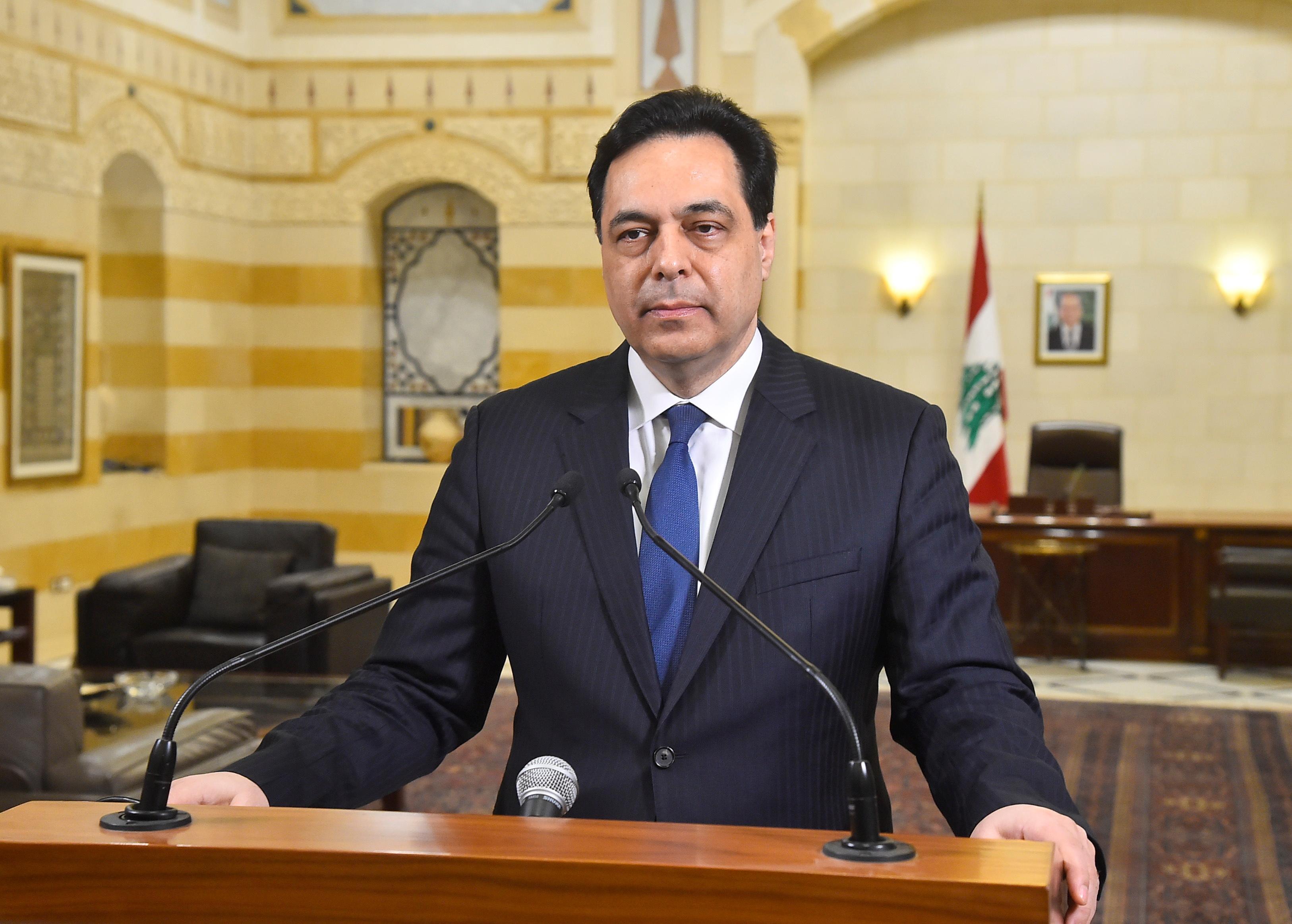 Lebanon's caretaker Prime Minister Hassan Diab speaks at the government palace in Beirut, Lebanon March 6, 2021. Dalati Nohra/Handout via REUTERS