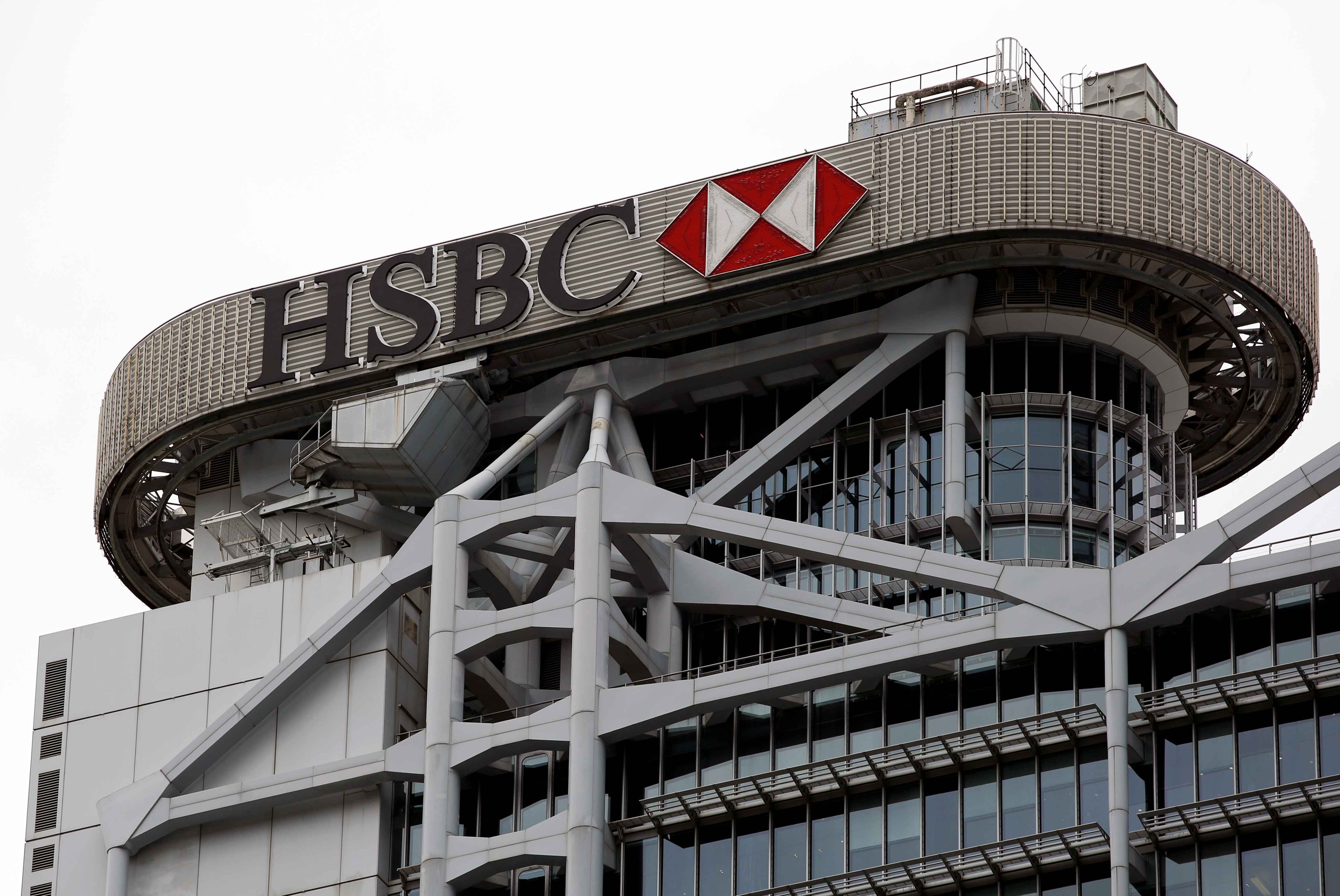 A logo of HSBC is seen on its headquarters at the financial Central district in Hong Kong, China August 4, 2020. REUTERS/Tyrone Siu/File Photo