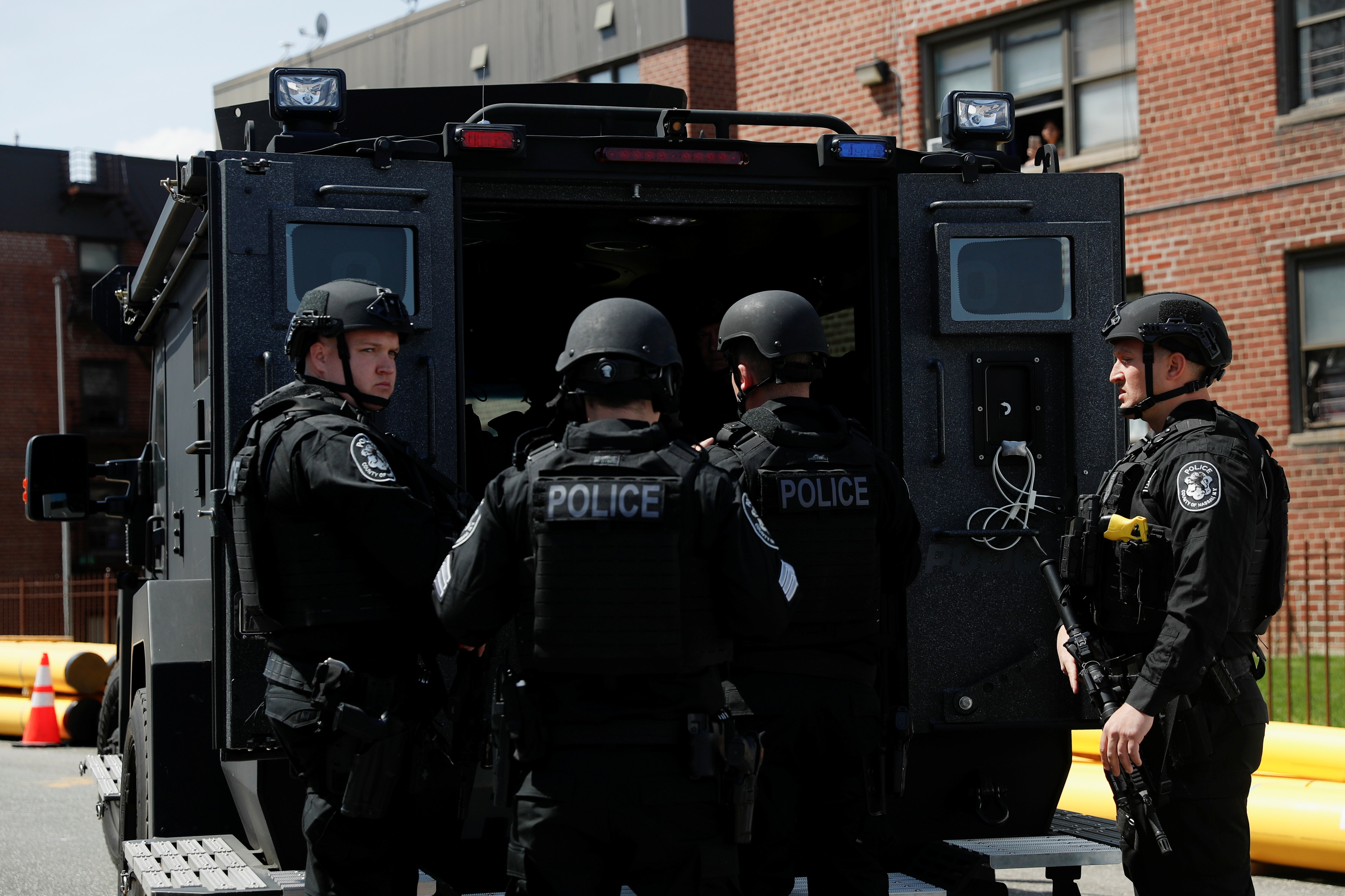 Law enforcement officers stand near the place where the shooter barricaded himself, after a shooting at a Stop and Shop grocery store, in Hempstead, New York, U.S., April 20, 2021.  REUTERS/Shannon Stapleton