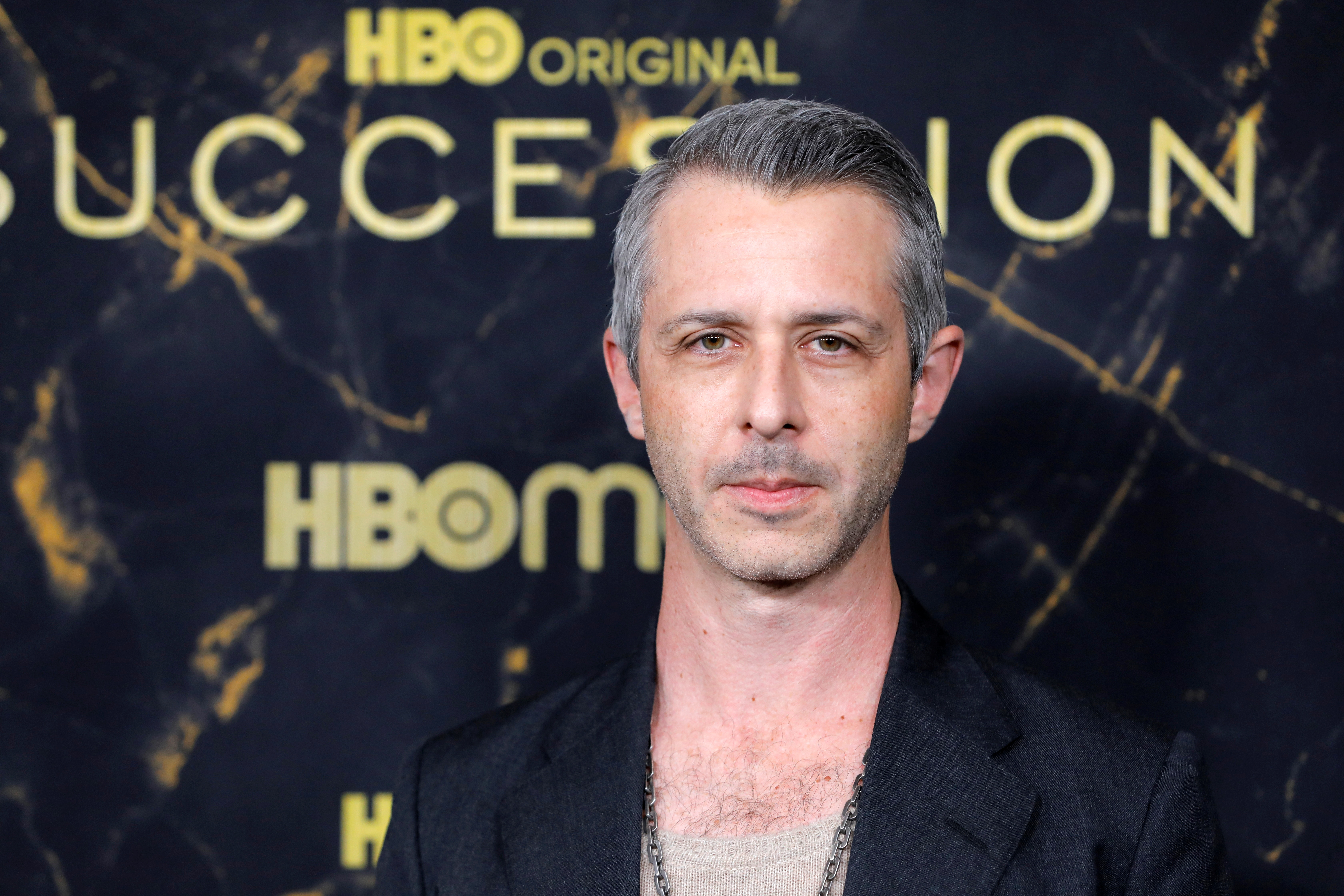 Jeremy Strong poses while attending the premiere of the third season of