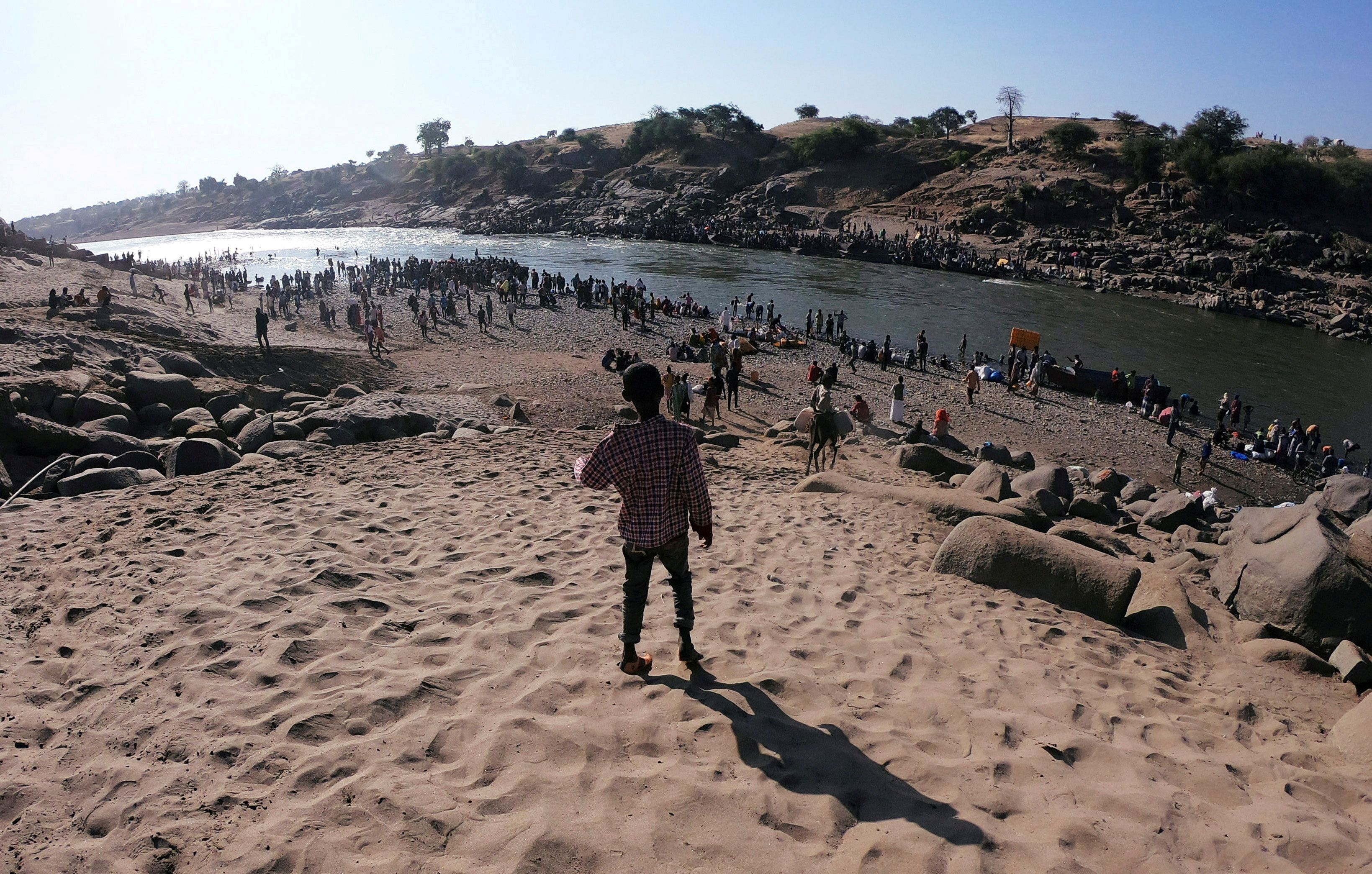 FILE PHOTO: Ethiopians are seen at the Tekeze River on the Sudan-Ethiopia border in Hamdayet village in eastern Kassala state