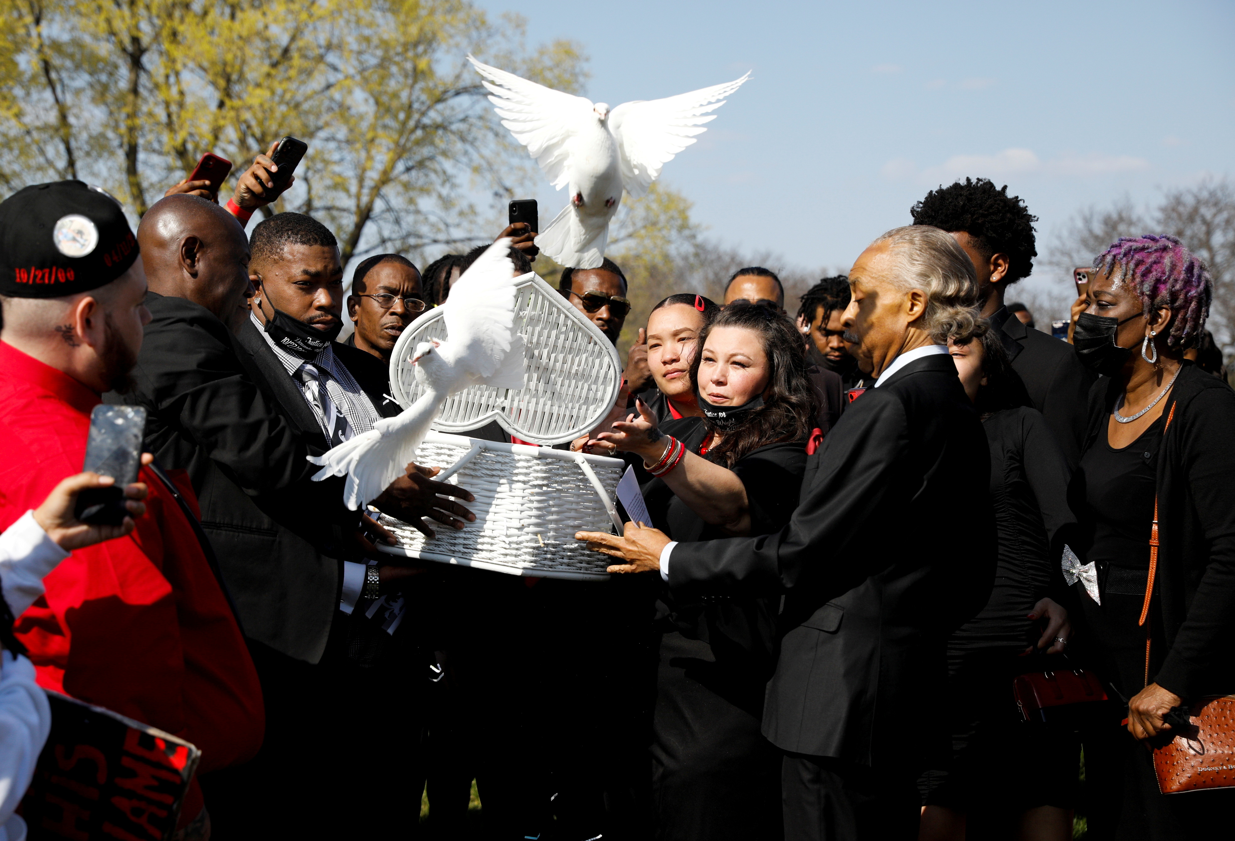 Katie Wright, the mother of Daunte Wright, a Black man who was fatally shot by a police officer after a routine traffic stop, accompanied by family members and Rev. Al Sharpton, releases doves during his funeral at Lakewood Cemetery, in Minneapolis, Minnesota, U.S., April 22, 2021. REUTERS/Nicholas Pfosi