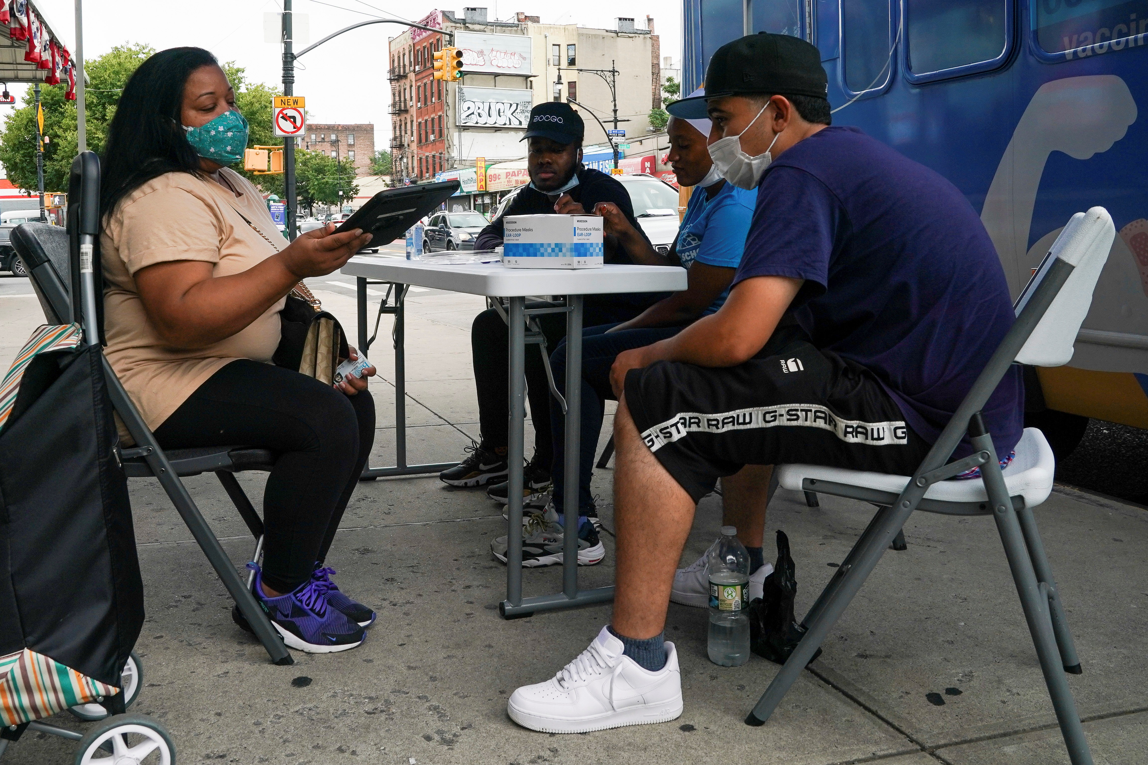 A person registers to receive a dose of the Pfizer-BioNTech vaccine for the coronavirus disease (COVID-19), at a mobile inoculation site in the Bronx borough of New York City, New York, U.S., August 18, 2021.  REUTERS/David 'Dee' Delgado