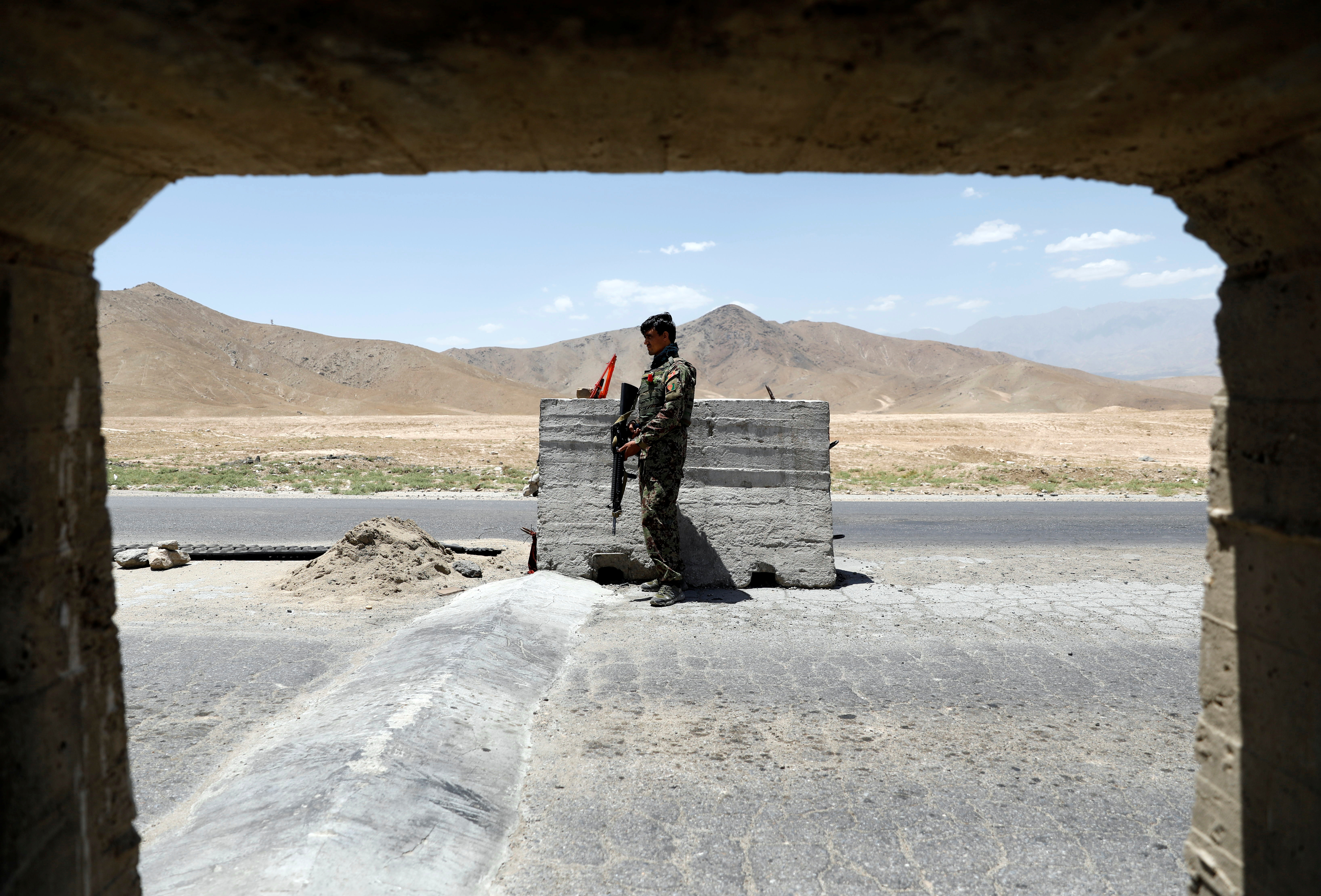 An Afghan National Army soldier stands guard at a check post near Bagram U.S. air base, on the day the last of American troops vacated it, Parwan province, Afghanistan July 2, 2021. REUTERS/Mohammad Ismail