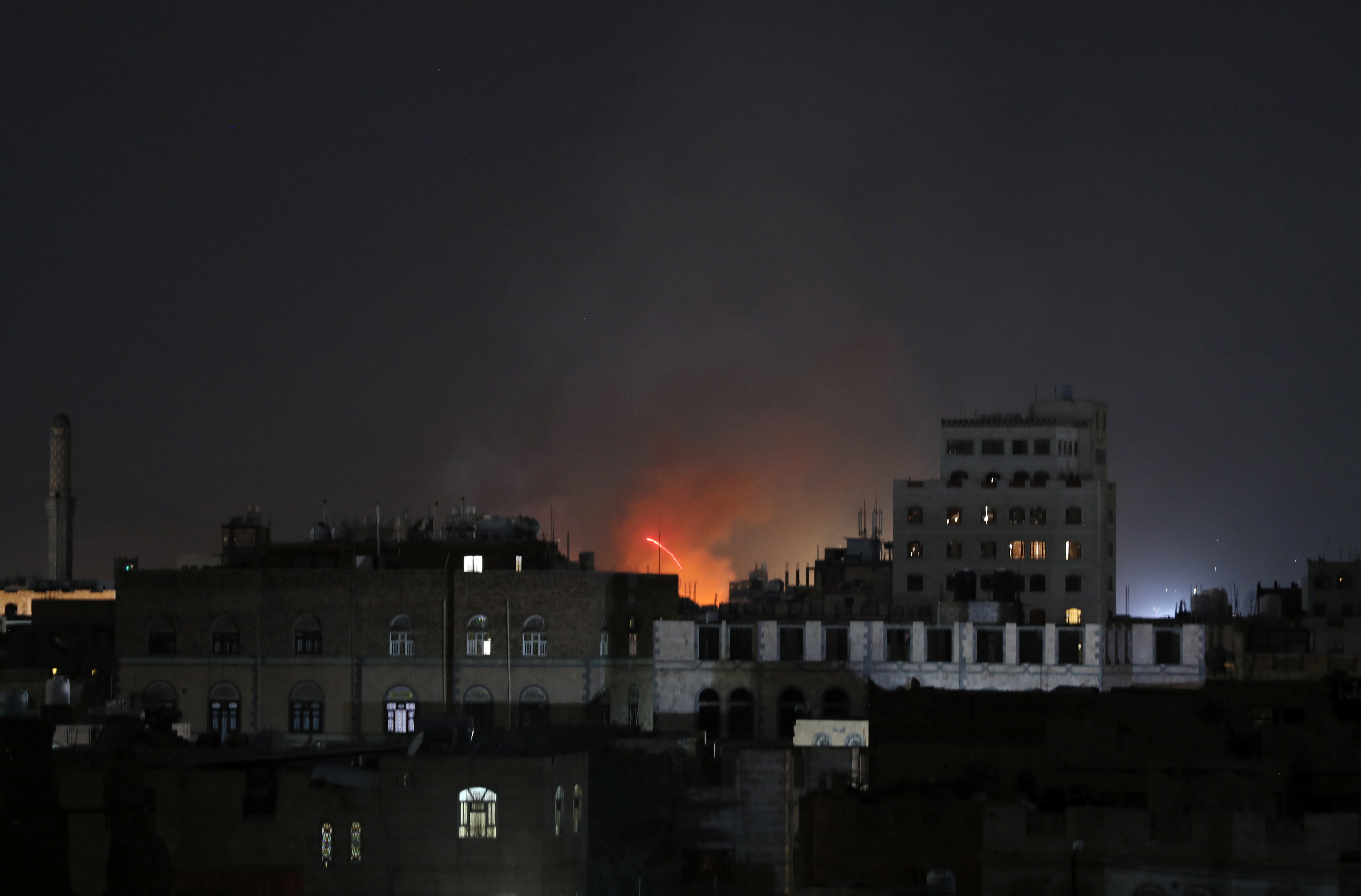 Fire is seen at a military site after it was hit by a Saudi-led air strike in Sanaa, Yemen April 26, 2021. REUTERS/Khaled Abdullah