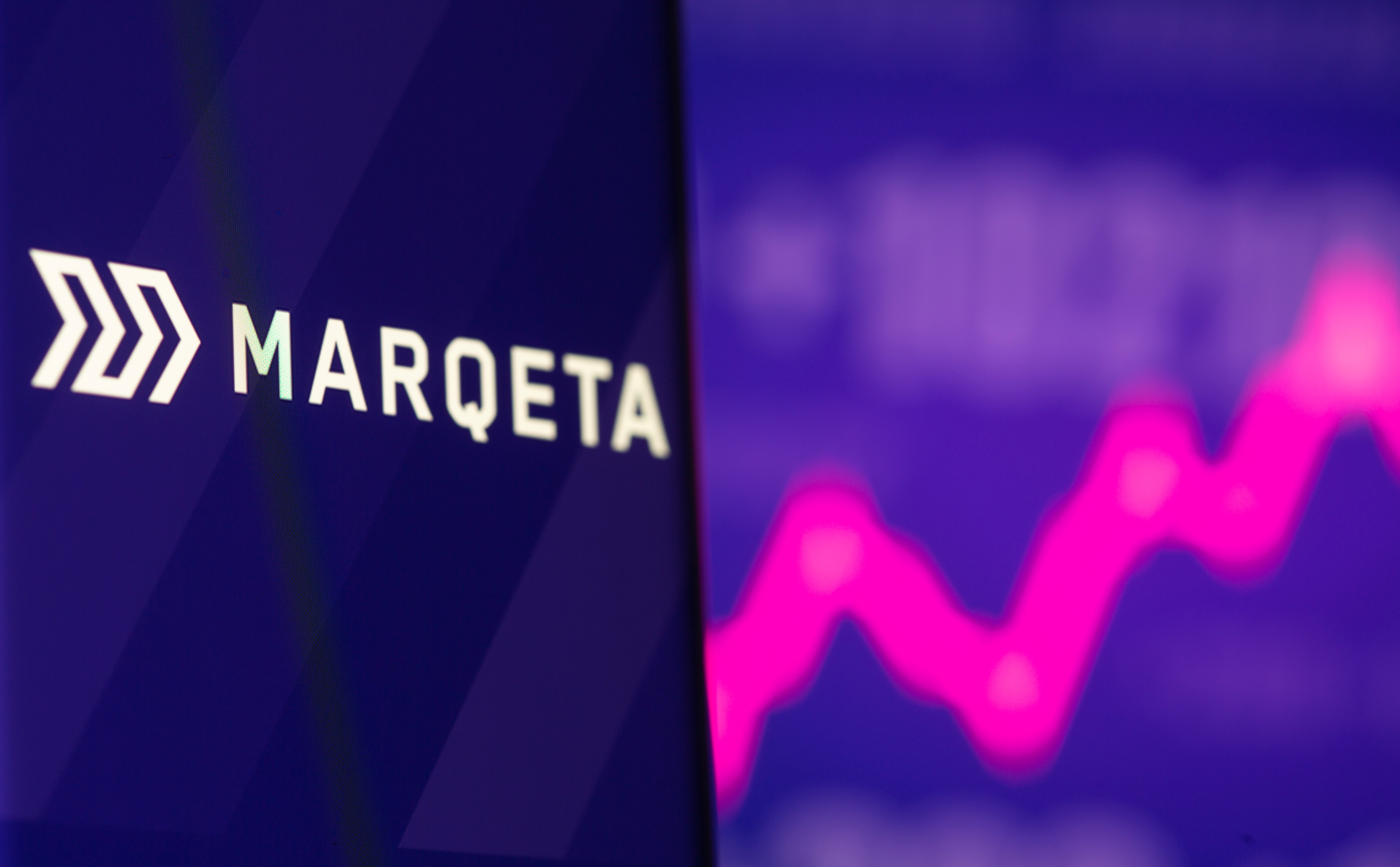 Marqeta logo is seen on a smartphone in front of displayed stock graph in this illustration picture taken June 9, 2021. REUTERS/Dado Ruvic/Illustration