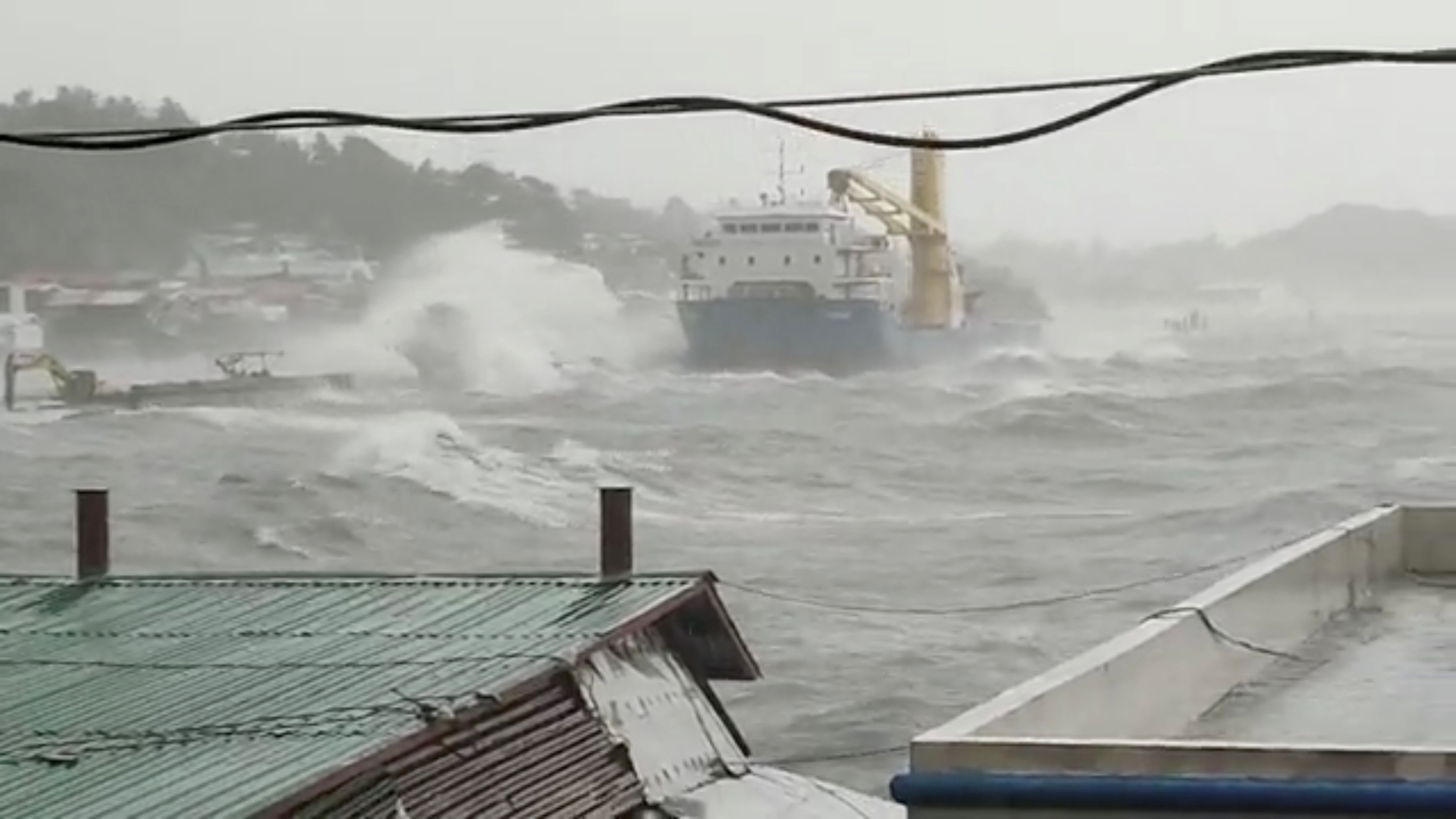 Waves crash the shore as Super Typhoon Surigae moves close to the Philippines in the province of Catbalogan, Samar, Philippines April 18, 2021, in this screen grab obtained from a social media video. DJ RJ RENE CASTINO via REUTERS