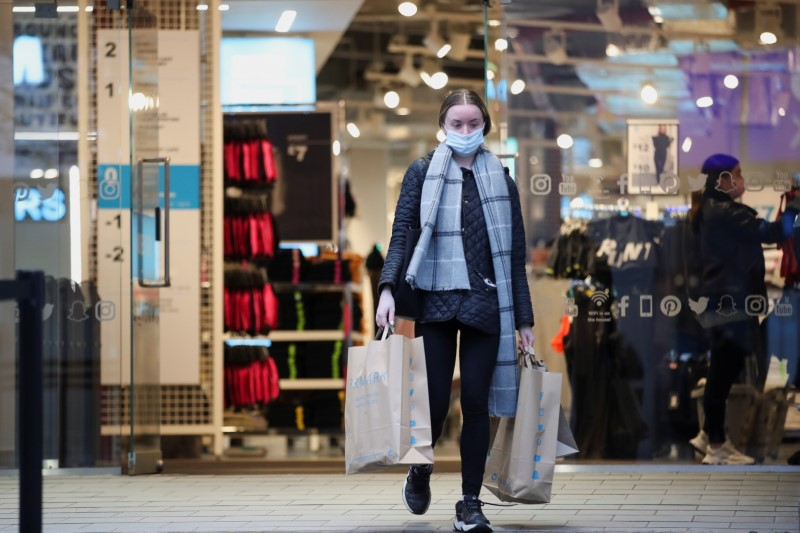 A customer leaves with shoping bags, as retail store Primark in Birmingham, Britain reopens its doors after a third lockdown imposed in early January due to the ongoing coronavirus disease (COVID-19) pandemic, April 12, 2021. REUTERS/Carl Recine/File photo