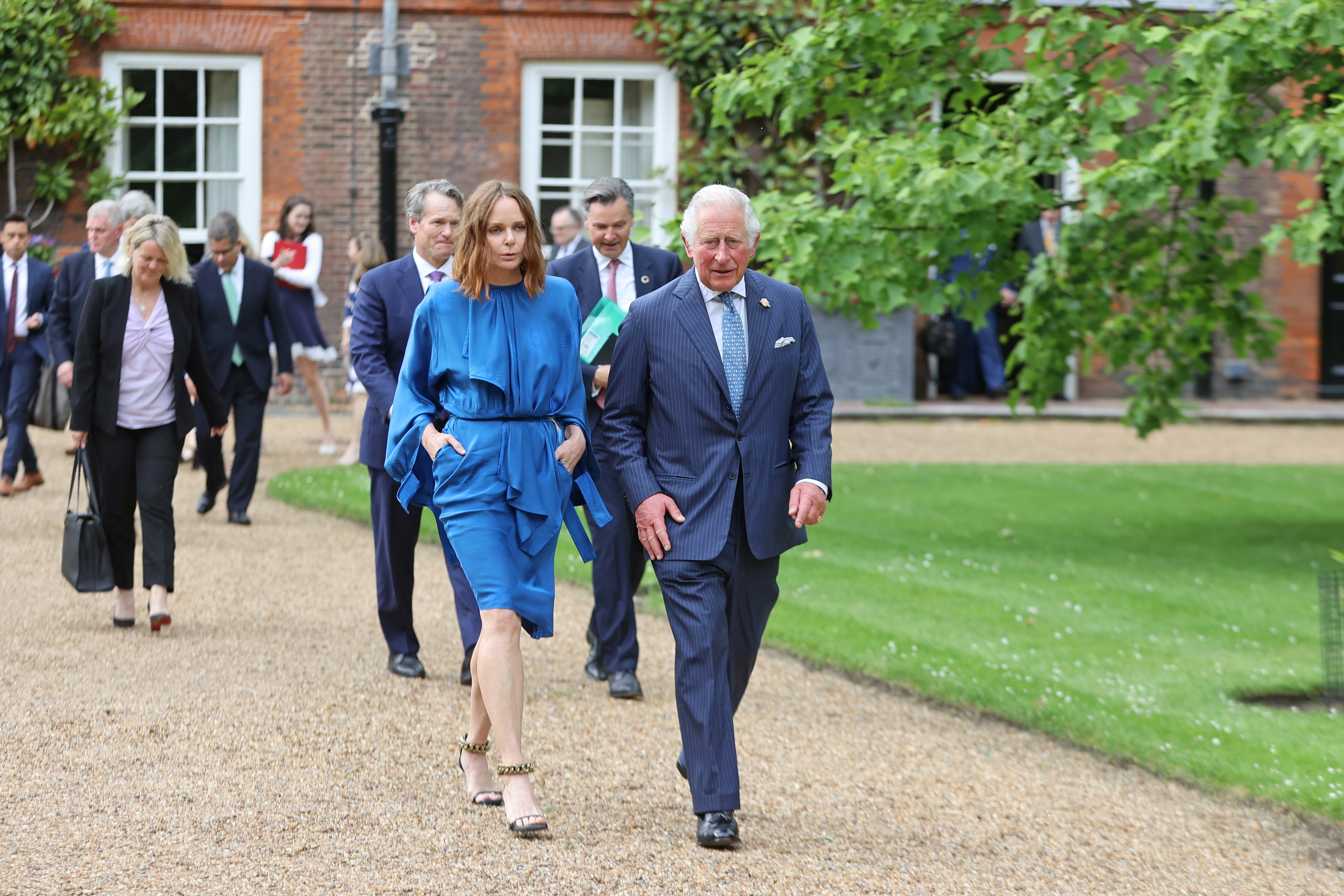 Stella McCartney and Britain's Prince Charles, who announced the Terra Carta Transition Coalitions, an organized, global collective working together to drive investment towards a sustainable future for Nature, People and Planet as a meeting and Coalitions' announcement form part of the wider G7 activity, depart St James Palace, London, Britain June 10, 2021. Chris Jackson/Pool via REUTERS