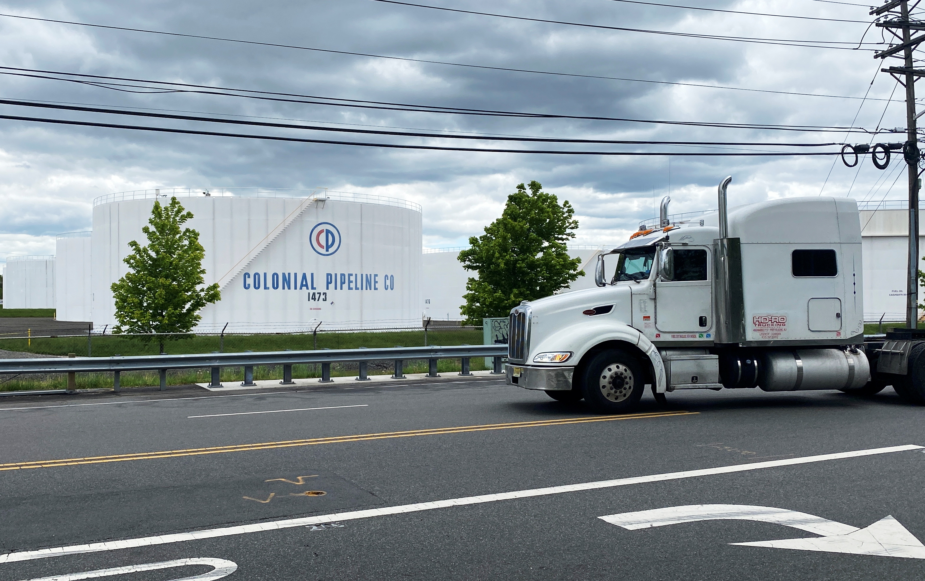 A truck passes holding tanks at Colonial Pipeline's Linden Junction Tank Farm in Woodbridge, New Jersey, U.S., May 10, 2021. REUTERS/Hussein Waaile