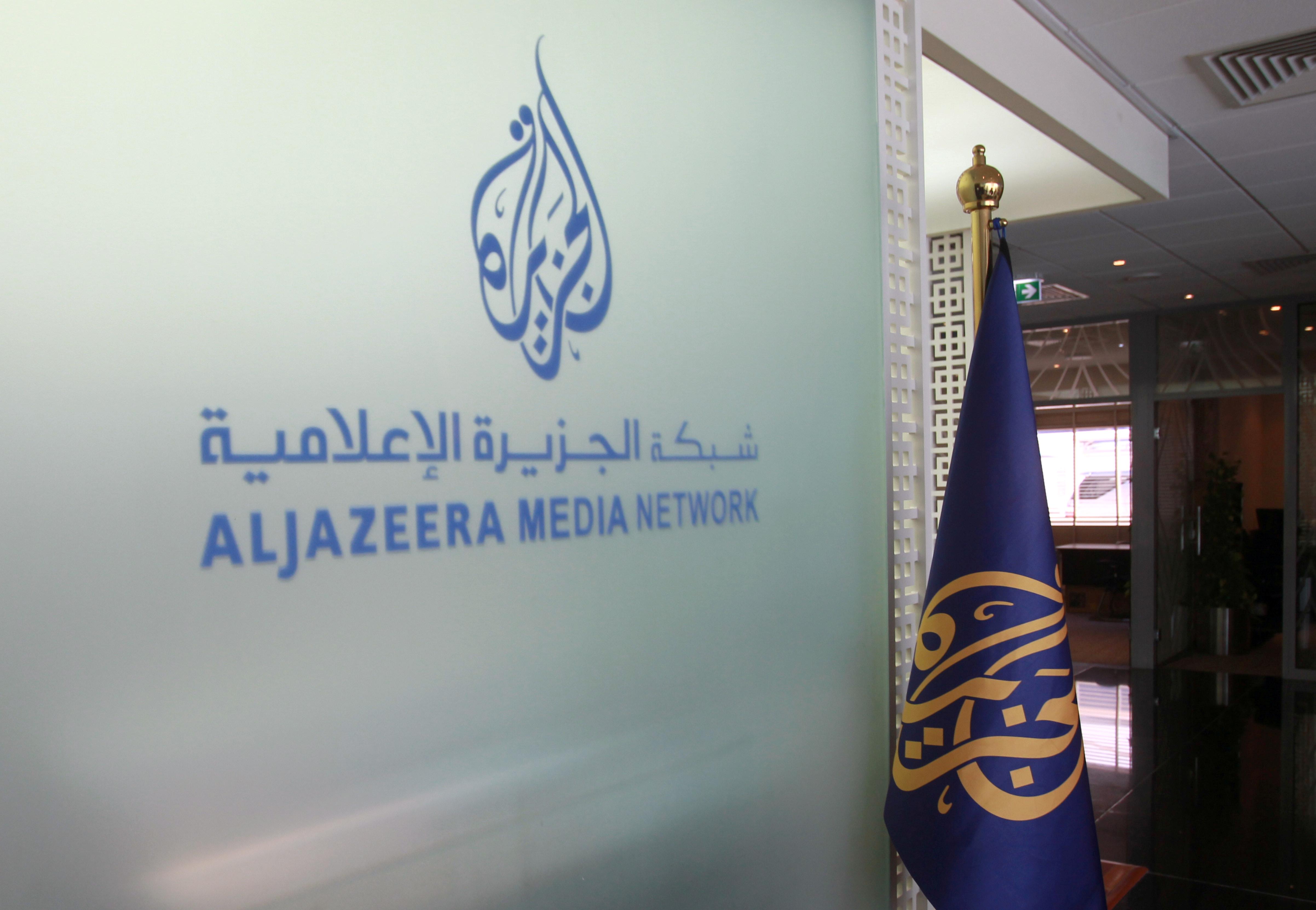 The Al Jazeera Media Network logo is seen inside its headquarters in Doha, Qatar June 8, 2017. REUTERS/Naseem Zeitoon