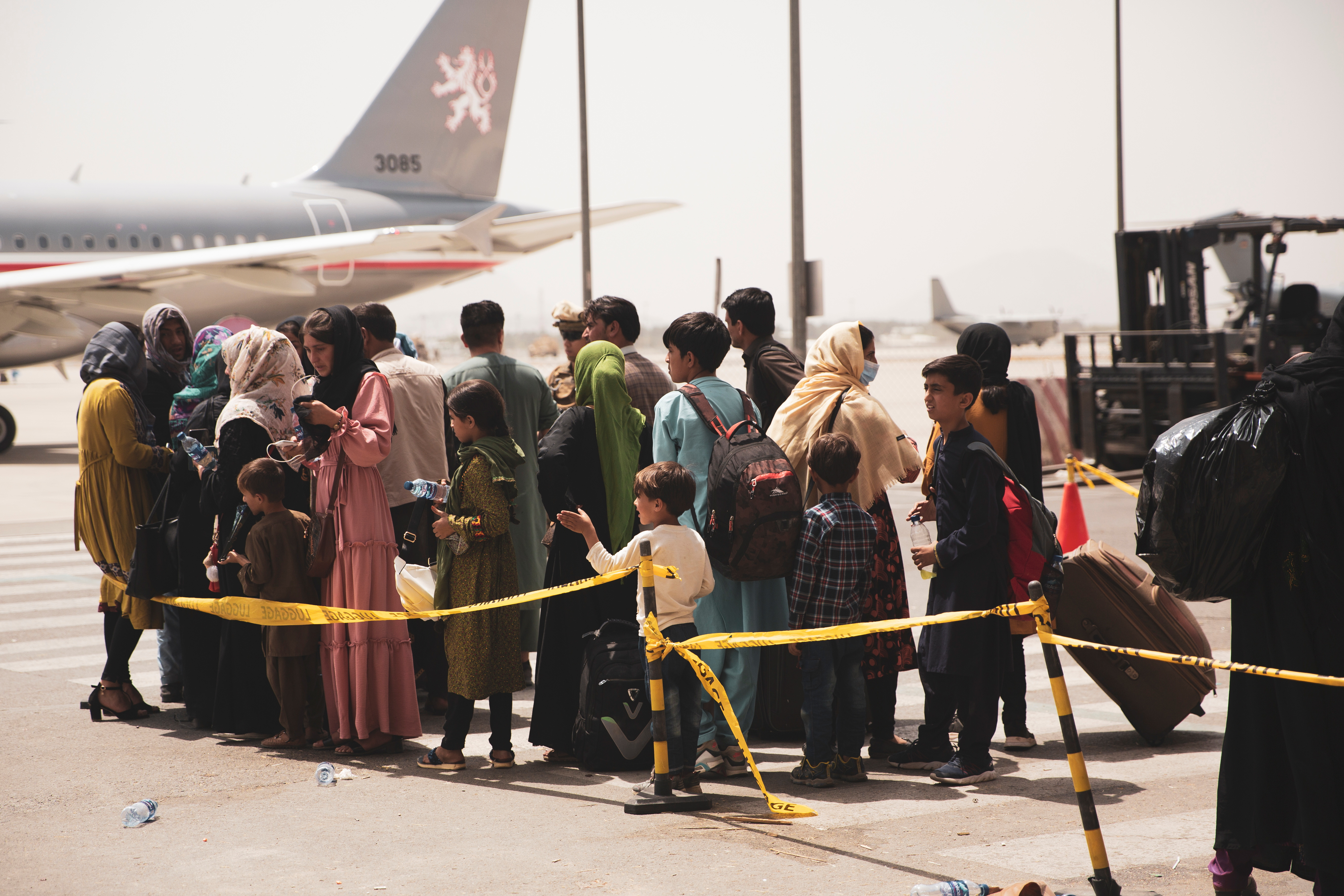 Civilians prepare to board a plane during an evacuation at Hamid Karzai International Airport, Kabul, Afghanistan August 18, 2021. U.S. Marine Corps/Staff Sgt. Victor Mancilla/Handout via REUTERS