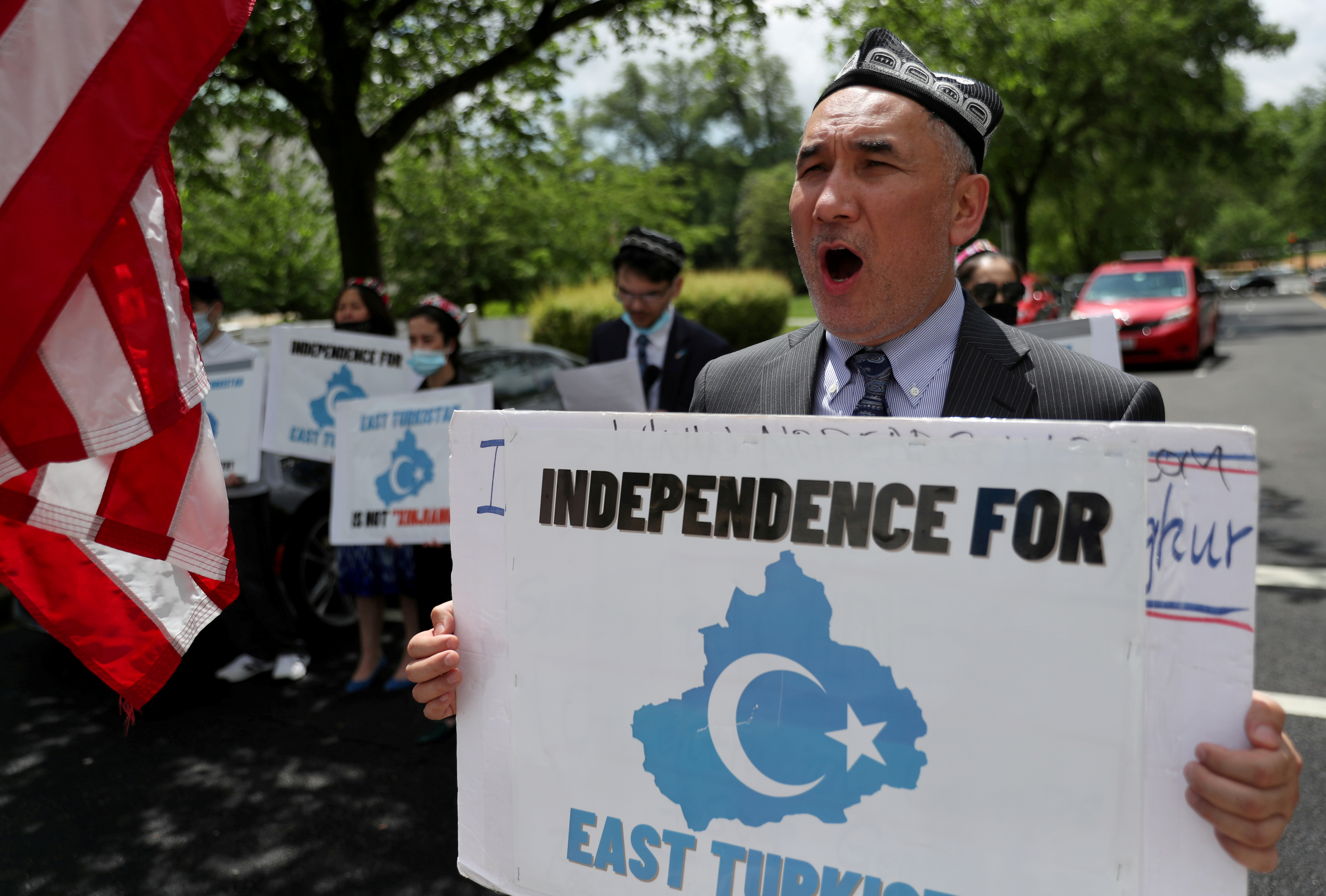 Demonstrators, including Aziz Sulayman, hold a protest in front of the U.S. State Department to commemorate Uyghur Doppa Day and to urge the U.S. and the international community to take action against China's treatment of the Uyghur people in the East Turkistan (Xinjiang) region, in Washington, U.S. May 5, 2021. REUTERS/Leah Millis