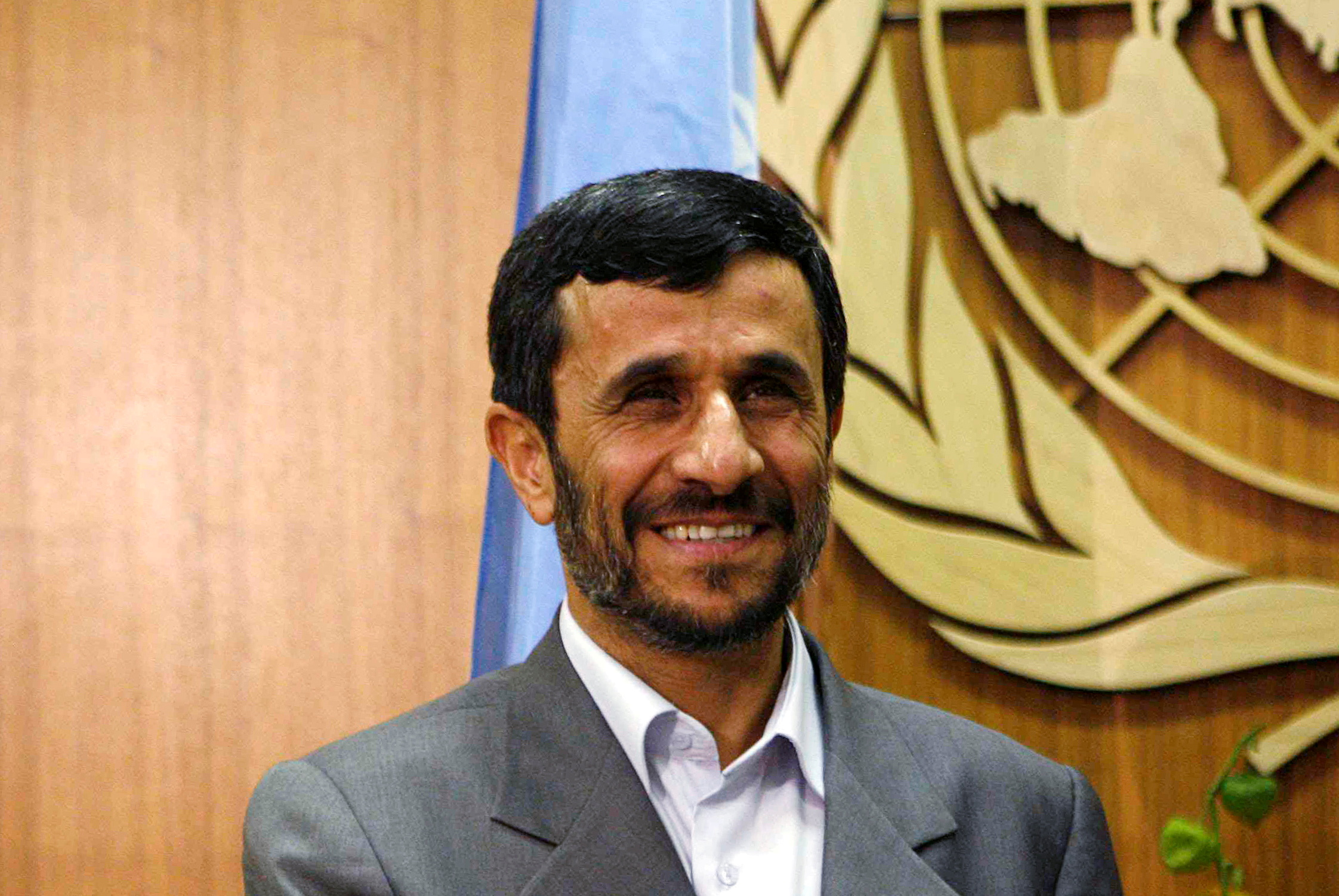 Iran's then President Mahmoud Ahmadinejad smiles as he meets with United Nations Secretary-General Ban Ki-moon at the United Nations in New York September 24, 2007. REUTERS/Eric Thayer/File Photo