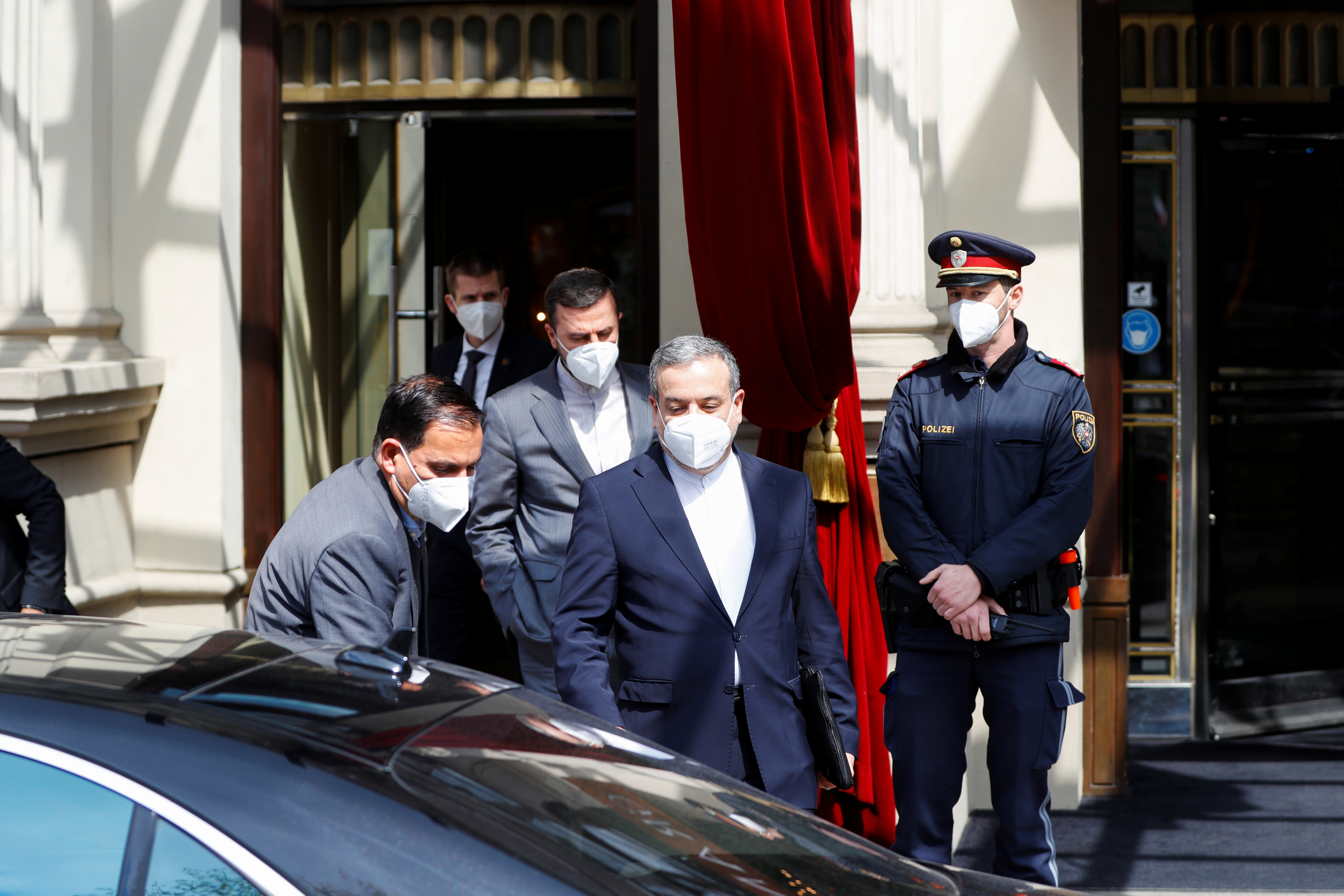 Iranian Deputy at the Ministry of Foreign Affairs Abbas Araghchi and Iran's ambassador to the U.N. nuclear watchdog Kazem Gharibabadi walk before a meeting of the Joint Commission of the Joint Comprehensive Plan of Action (JCPOA), in Vienna, Austria, April 20, 2021. REUTERS/Leonhard Foeger