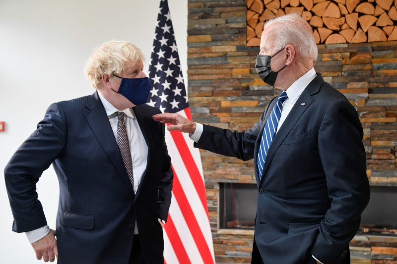 U.S. President Joe Biden speaks with Britain's Prime Minister Boris Johnson, as they look at historical documents and artefacts relating to the Atlantic Charter during their meeting, at Carbis Bay Hotel, Carbis Bay, Cornwall, Britain June 10, 2021. REUTERS/Toby Melville/Pool/File photo