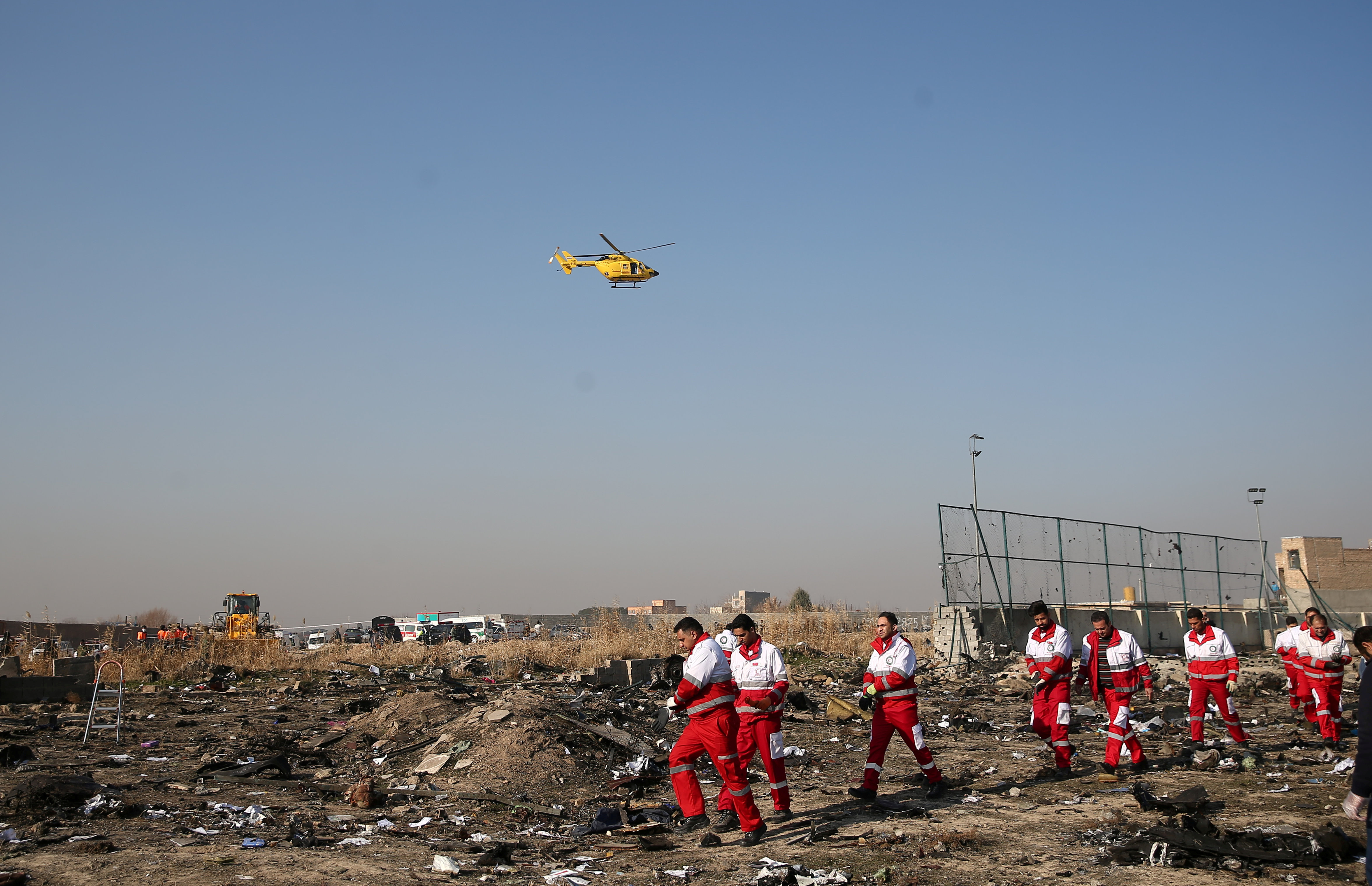 Rescue team works among debris of a plane belonging to Ukraine International Airlines, that crashed after take-off from Iran's Imam Khomeini airport, on the outskirts of Tehran, Iran January 8, 2020. Nazanin Tabatabaee/WANA (West Asia News Agency) via REUTERS