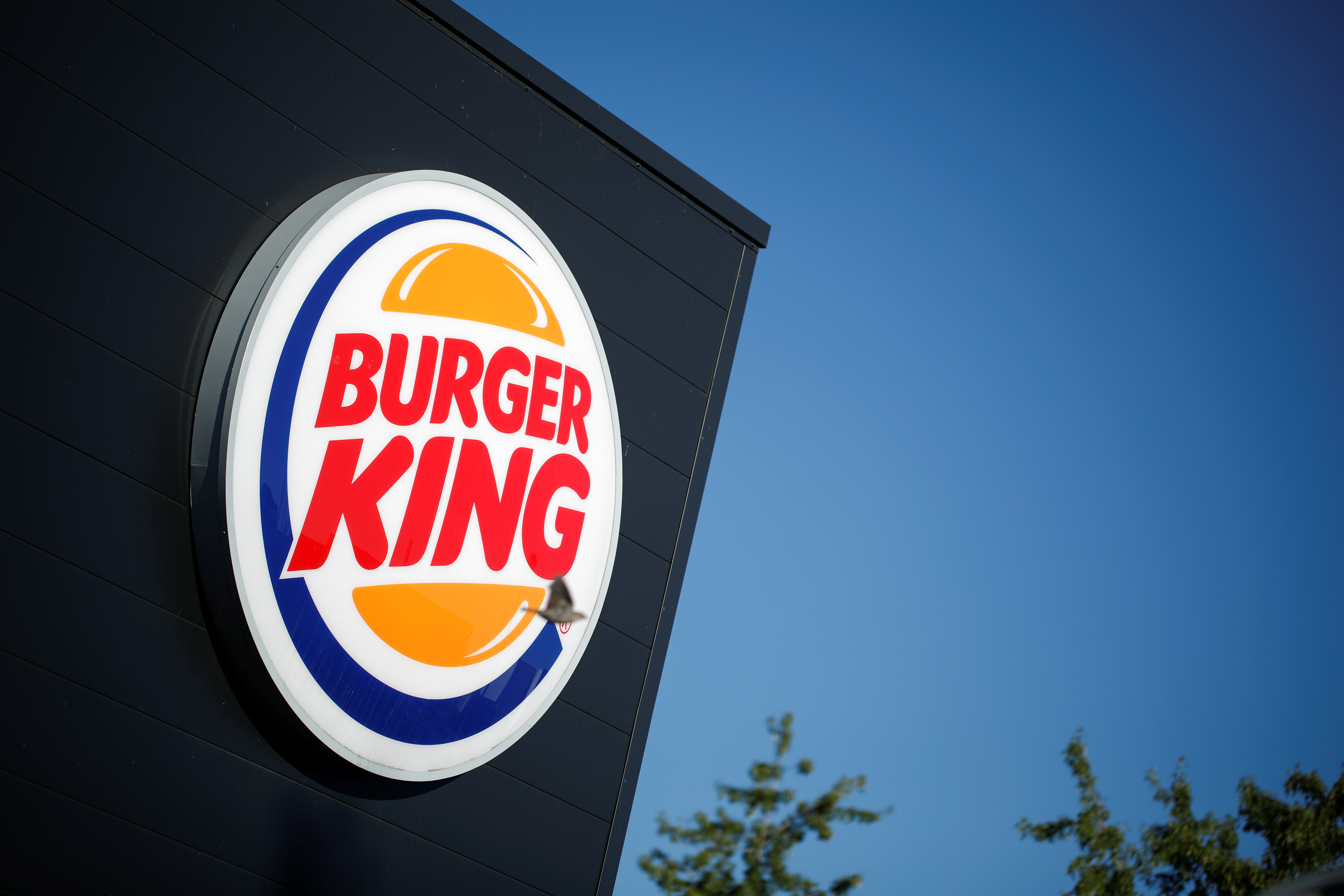 The Burger King company logo stands on a sign outside a restaurant in Bretigny-sur-Orge, near Paris, France, July 30, 2020. REUTERS/Benoit Tessier