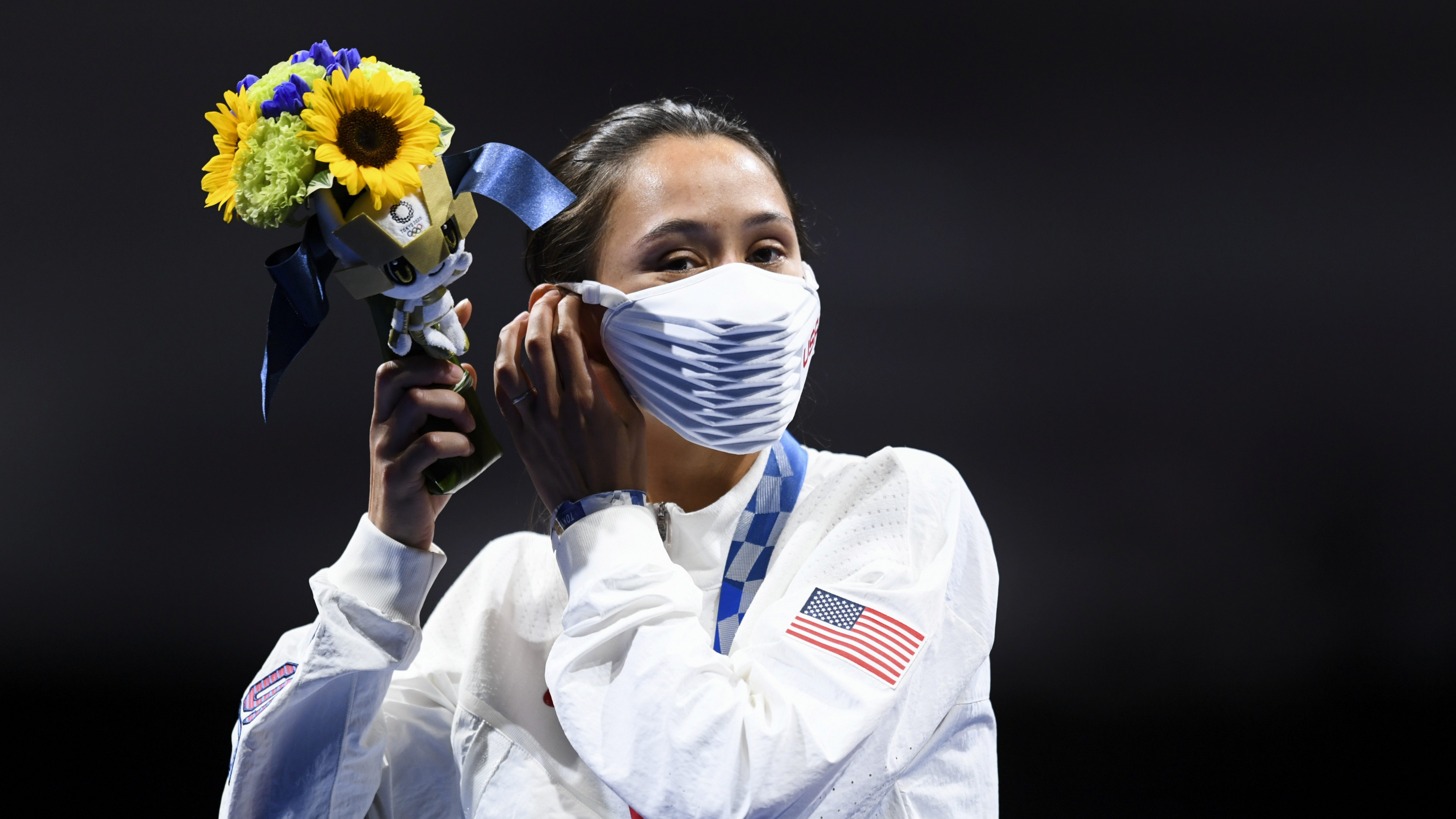 Tokyo 2020 Olympics - Fencing - Women's Individual Foil - Medal Ceremony - Makuhari Messe Hall B - Chiba, Japan - July 25, 2021. Gold medallist Lee Kiefer of the United States celebrates on the podium REUTERS/Annegret Hilse