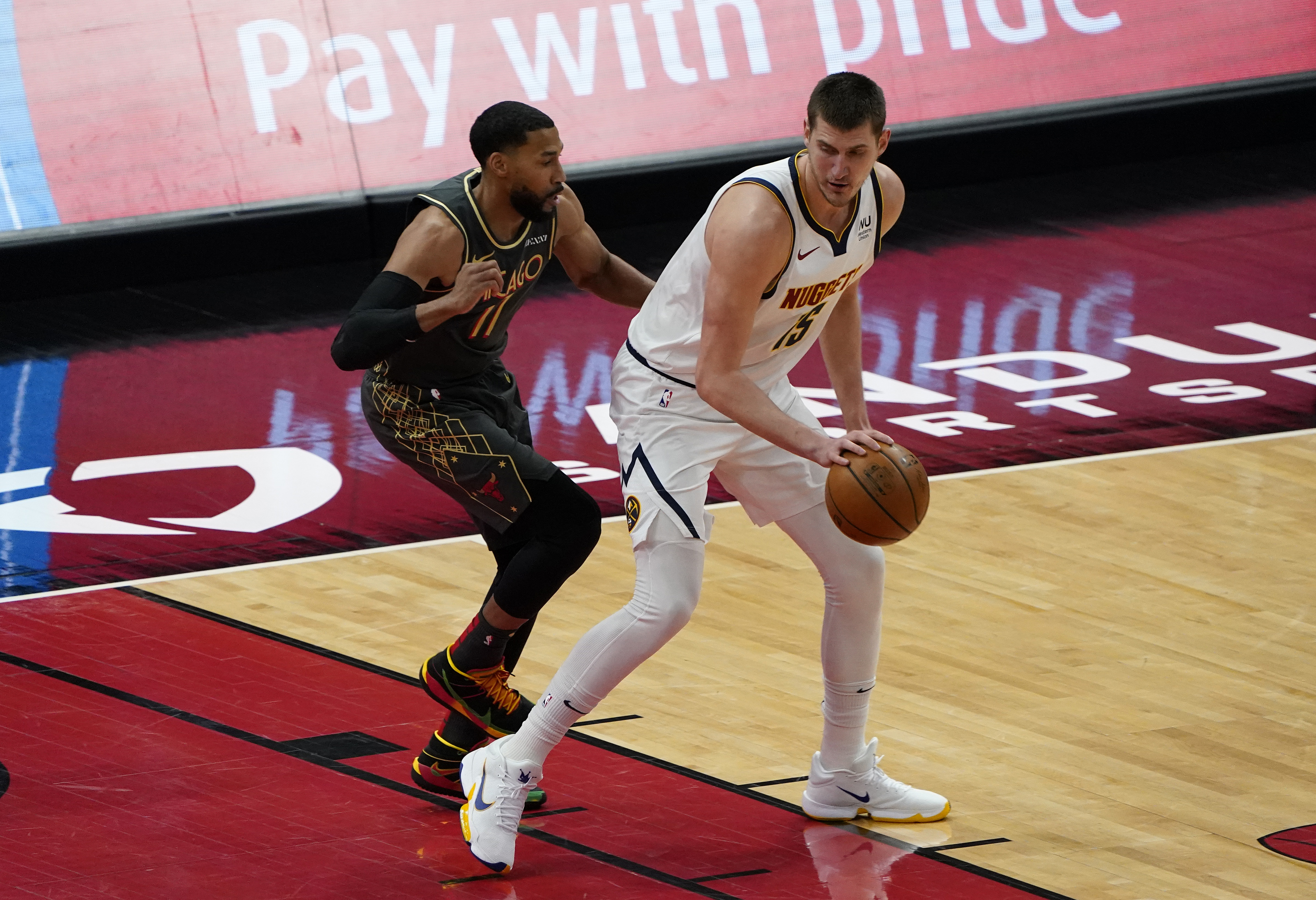 Mar 1, 2021; Chicago, Illinois, USA; Denver Nuggets center Nikola Jokic (15) dribbles the ball against Chicago Bulls guard Garrett Temple (17) during the first quarter at the United Center. Mandatory Credit: Mike Dinovo-USA TODAY Sports