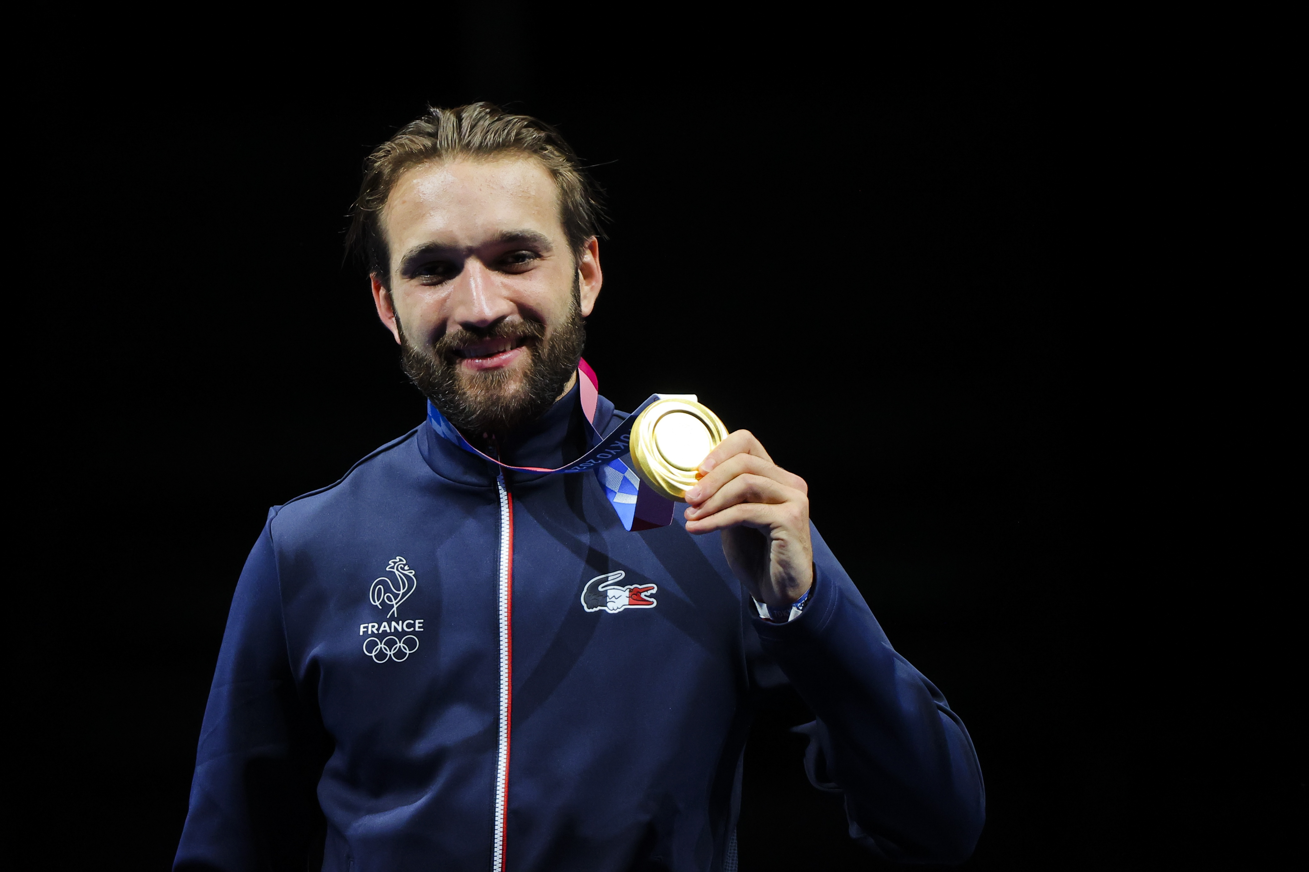 Tokyo 2020 Olympics - Fencing - Men's Individual Epee - Medal Ceremony - Makuhari Messe Hall B - Chiba, Japan - July 25, 2021. Gold medallist Romain Cannone of France celebrates on the podium REUTERS/Maxim Shemetov