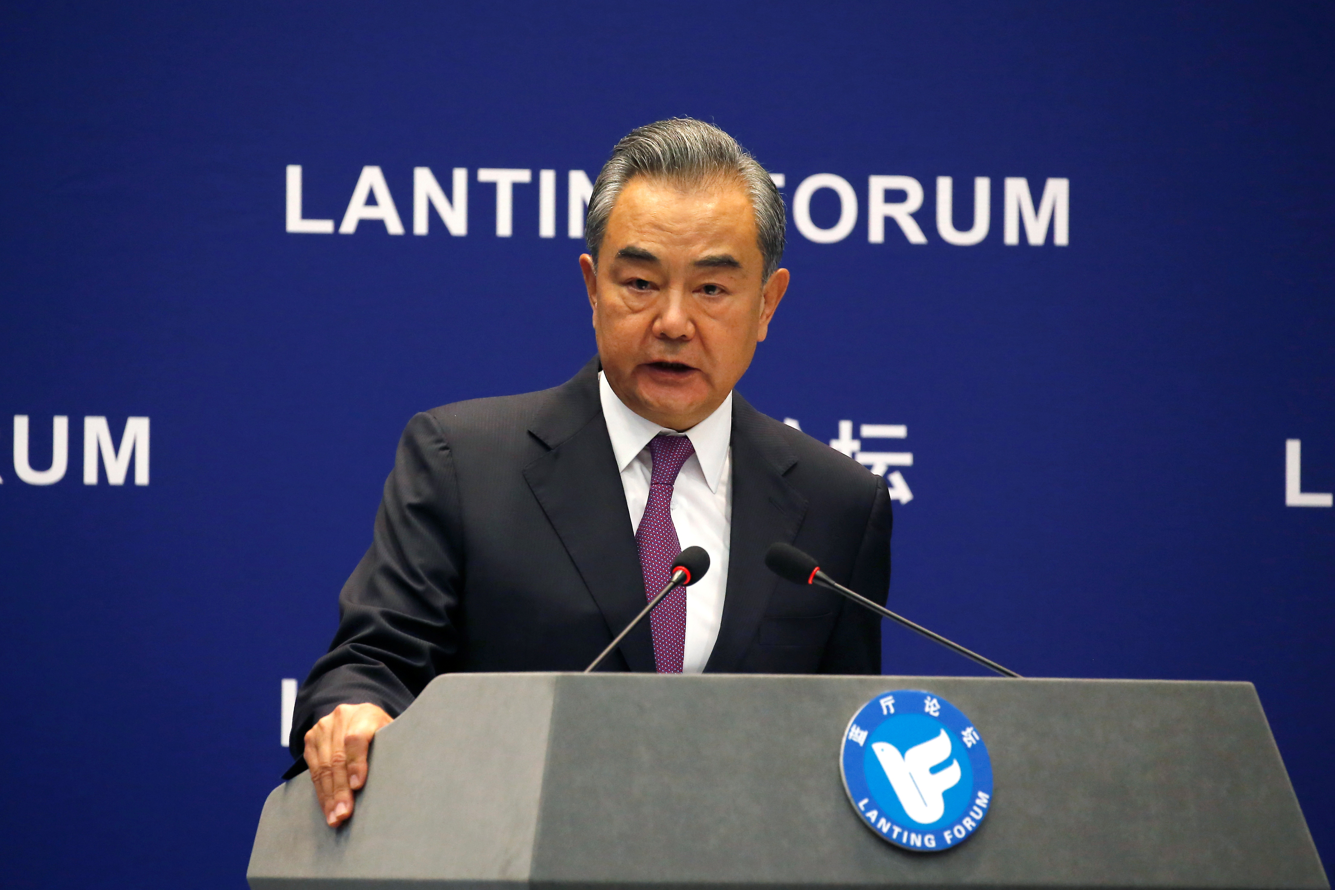Chinese State Councillor and Foreign Minister Wang Yi speaks at a Lanting Forum with the theme
