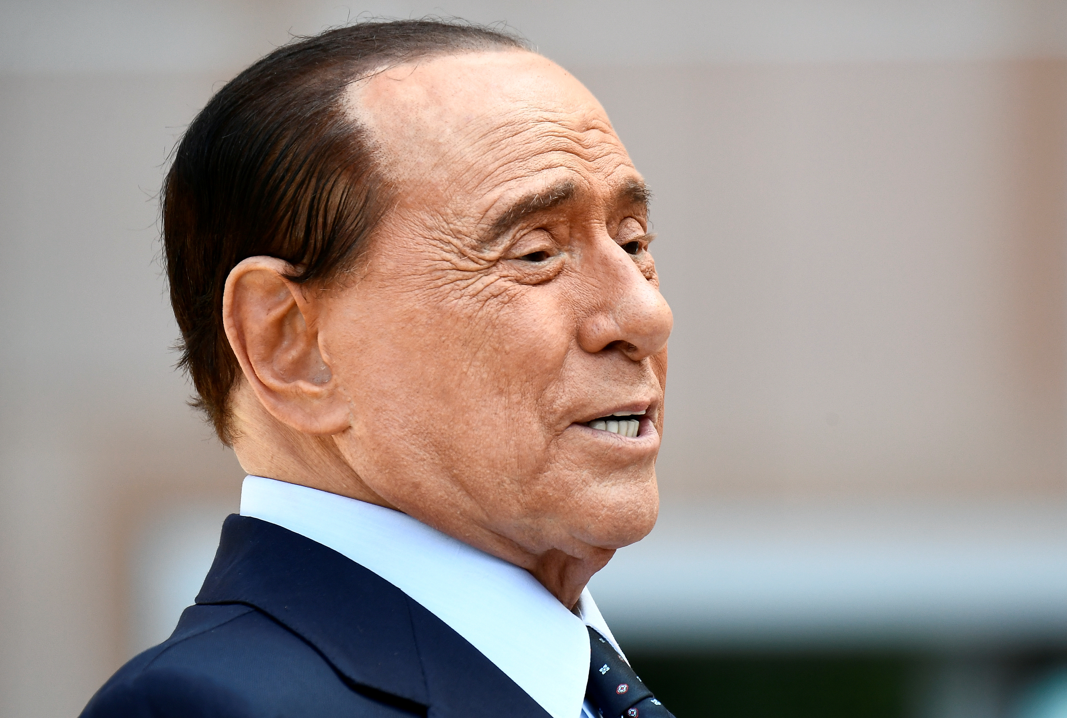 Former Italian Prime Minister Silvio Berlusconi speaks to the media as he leaves Milan's San Raffaele hospital, where he was being treated after testing positive for the coronavirus disease (COVID-19) and diagnosed with mild pneumonia, in Milan, Italy, September 14, 2020. REUTERS/Flavio Lo Scalzo/File Photo