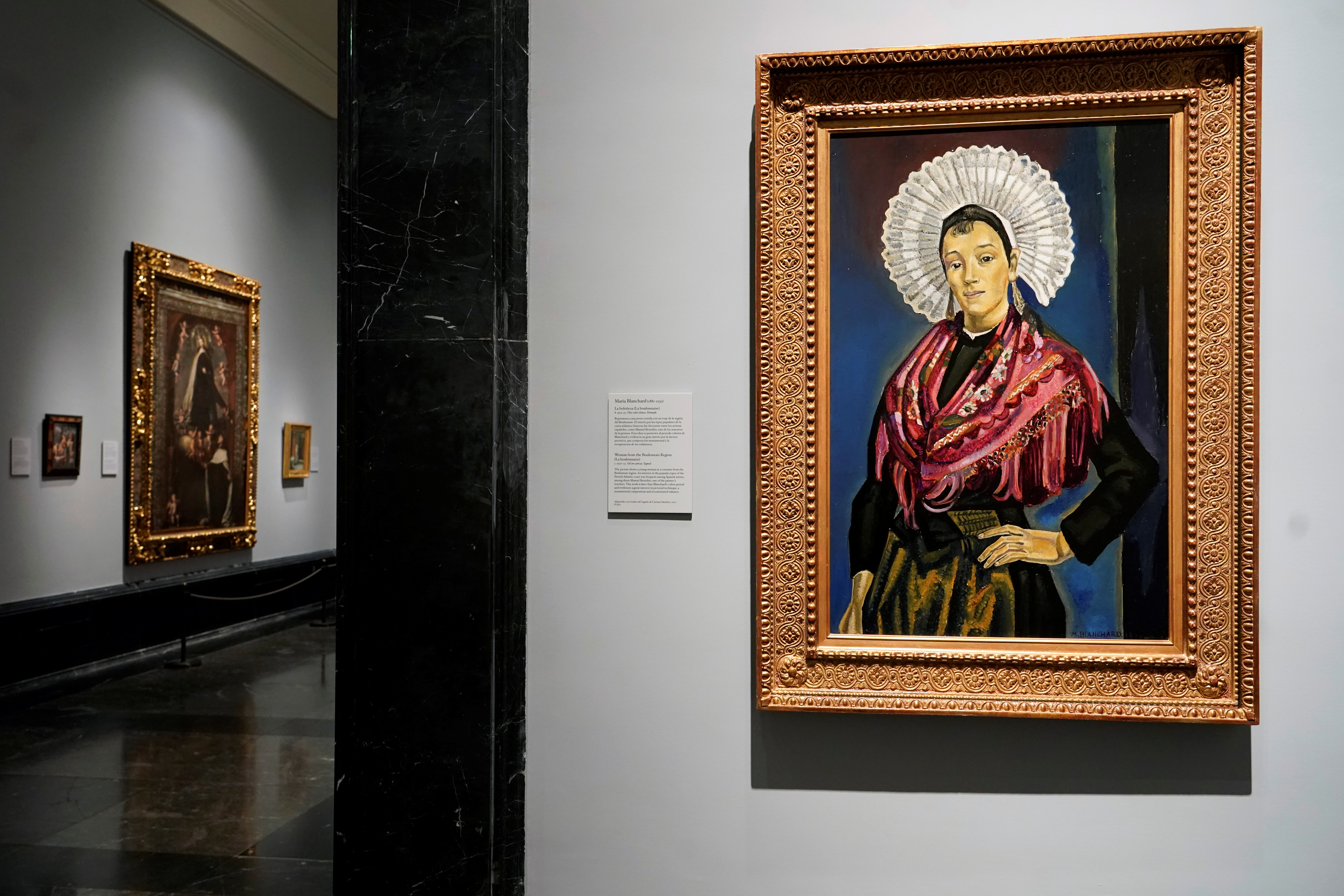 The portrait called La Bolonesa (The Bolognese) painted by Maria Blanchard is seen at El Prado Museum in Madrid, Spain July 21, 2021. REUTERS/Juan Medina NO RESALES. NO ARCHIVES