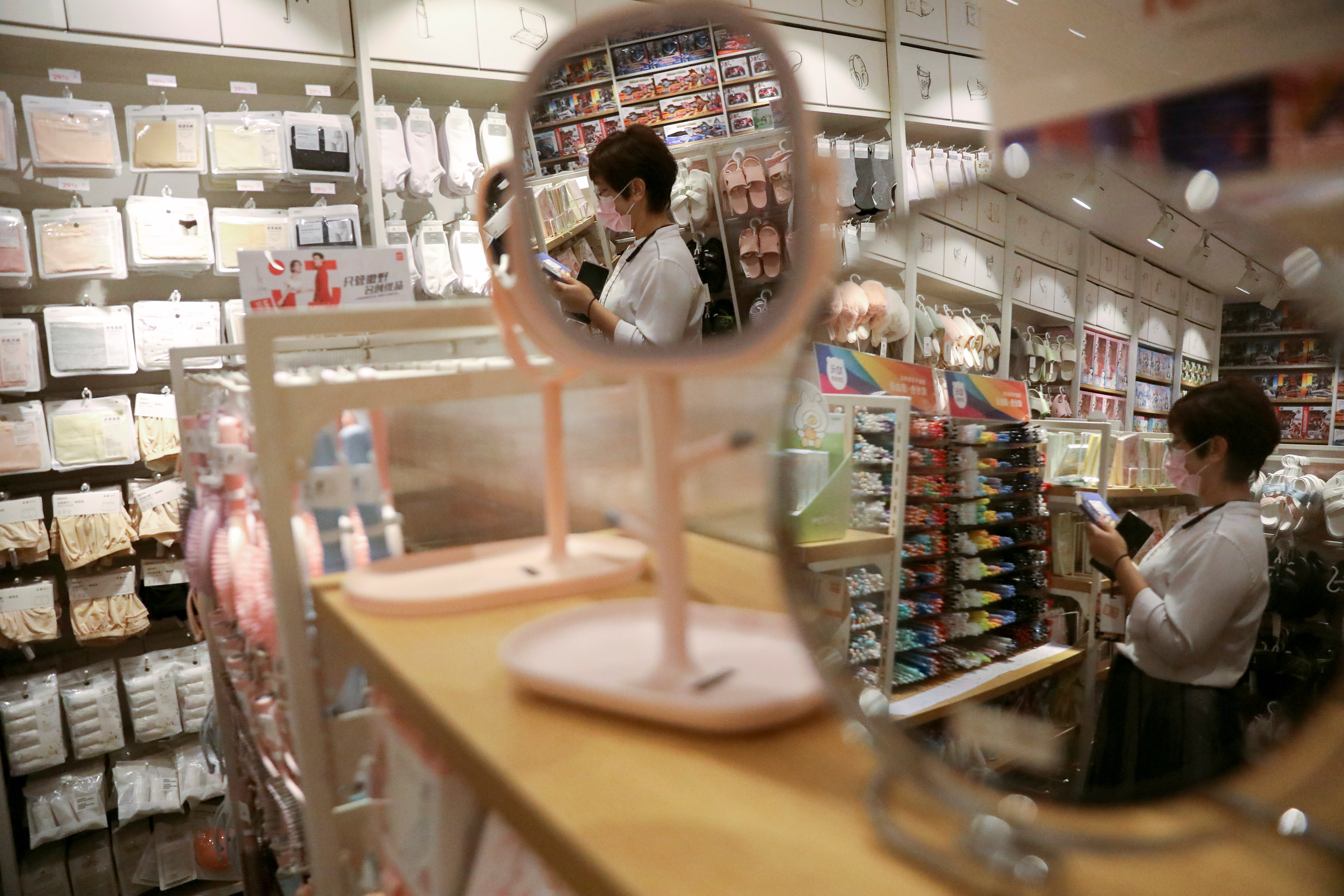 A customer shops at a store of Chinese retailer MINISO Group in Beijing, China September 13, 2021. REUTERS/Tingshu Wang