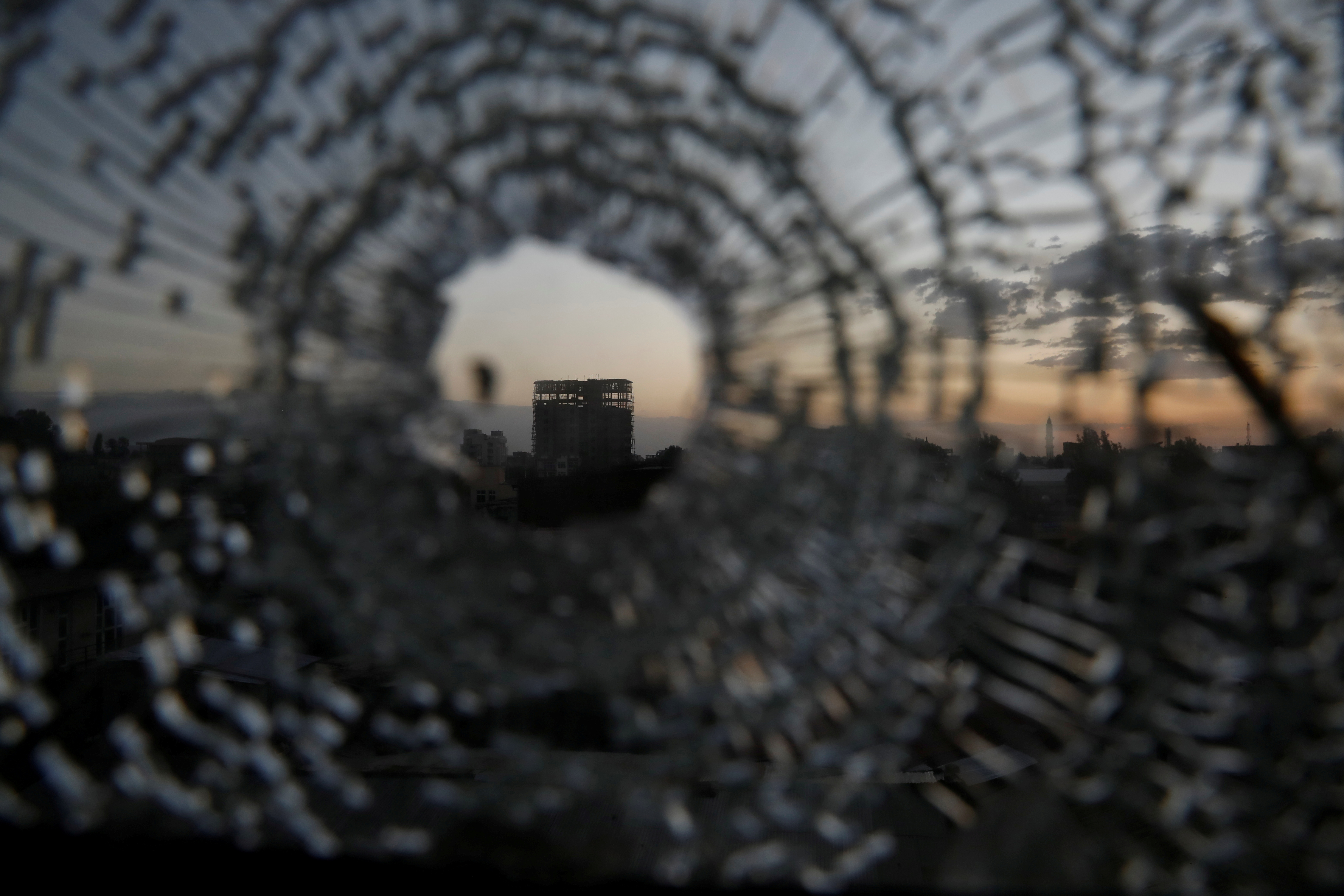 A building is seen through a bullet hole in a window of the Africa Hotel in the town of Shire, Tigray region, Ethiopia, March 16, 2021.  REUTERS/Baz Ratner/File Photo