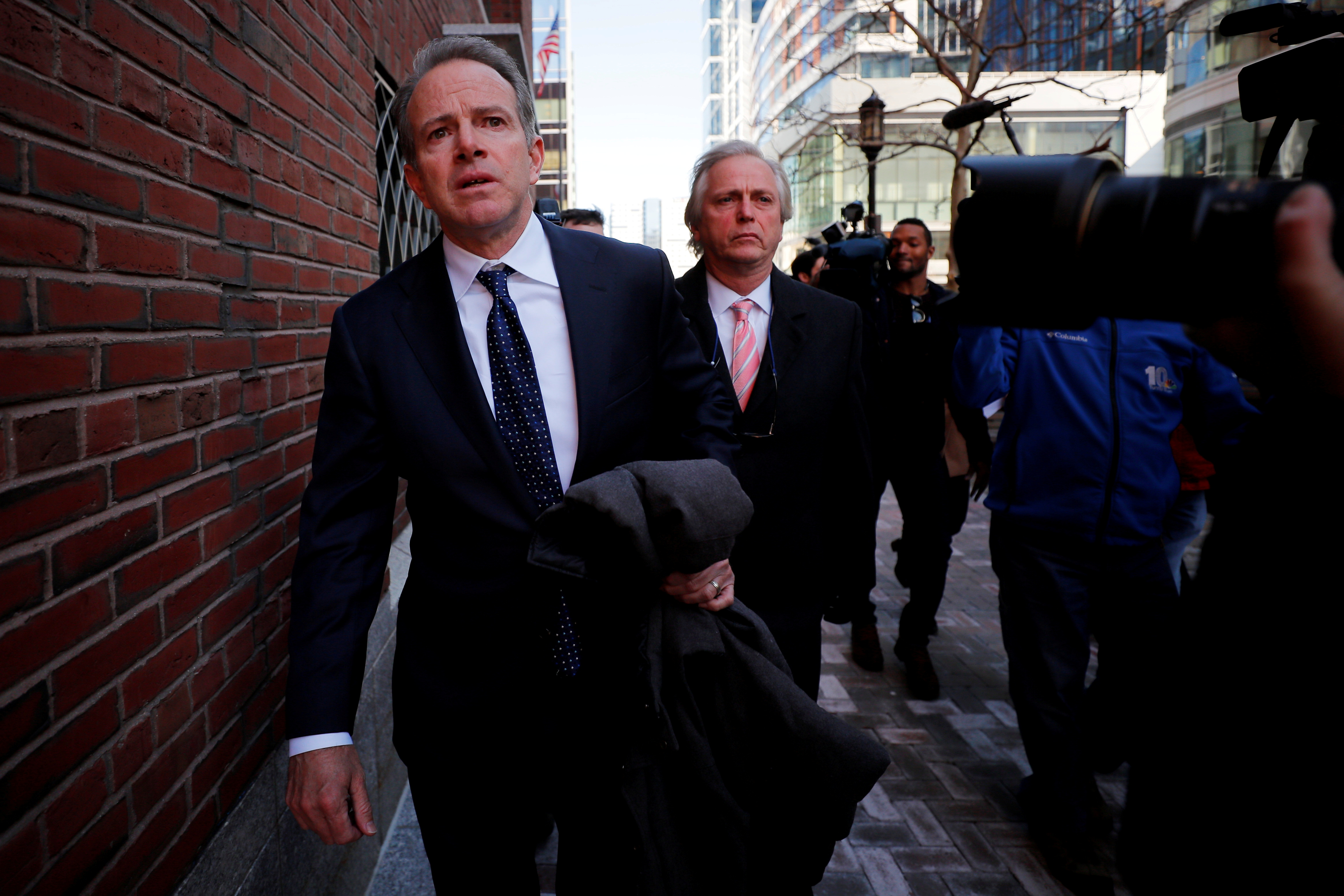 Gordon Ernst, Georgetown University's former head tennis coach facing charges in a nationwide college admissions cheating scheme, leaves the federal courthouse in Boston, Massachusetts, U.S., March 25, 2019.   REUTERS/Brian Snyder/File Photo
