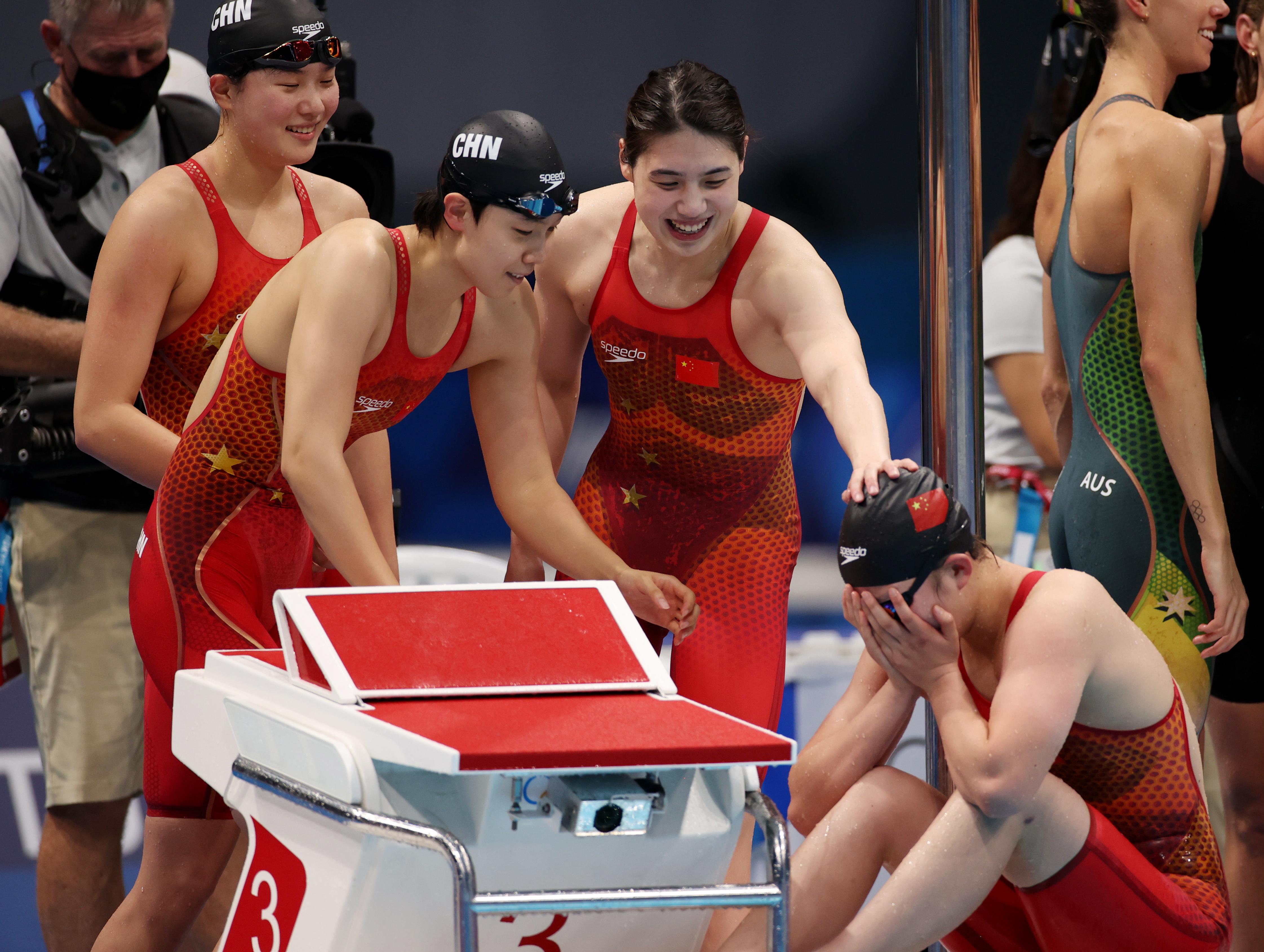 Tokyo 2020 Olympics - Swimming - Women's 4 x 200m Freestyle Relay - Final - Tokyo Aquatics Centre - Tokyo, Japan - July 29, 2021. Yang Junxuan of China, Tang Muhan of China, Zhang Yufei of China and Li Bingjie of China react after winning and setting a world record REUTERS/Molly Darlington