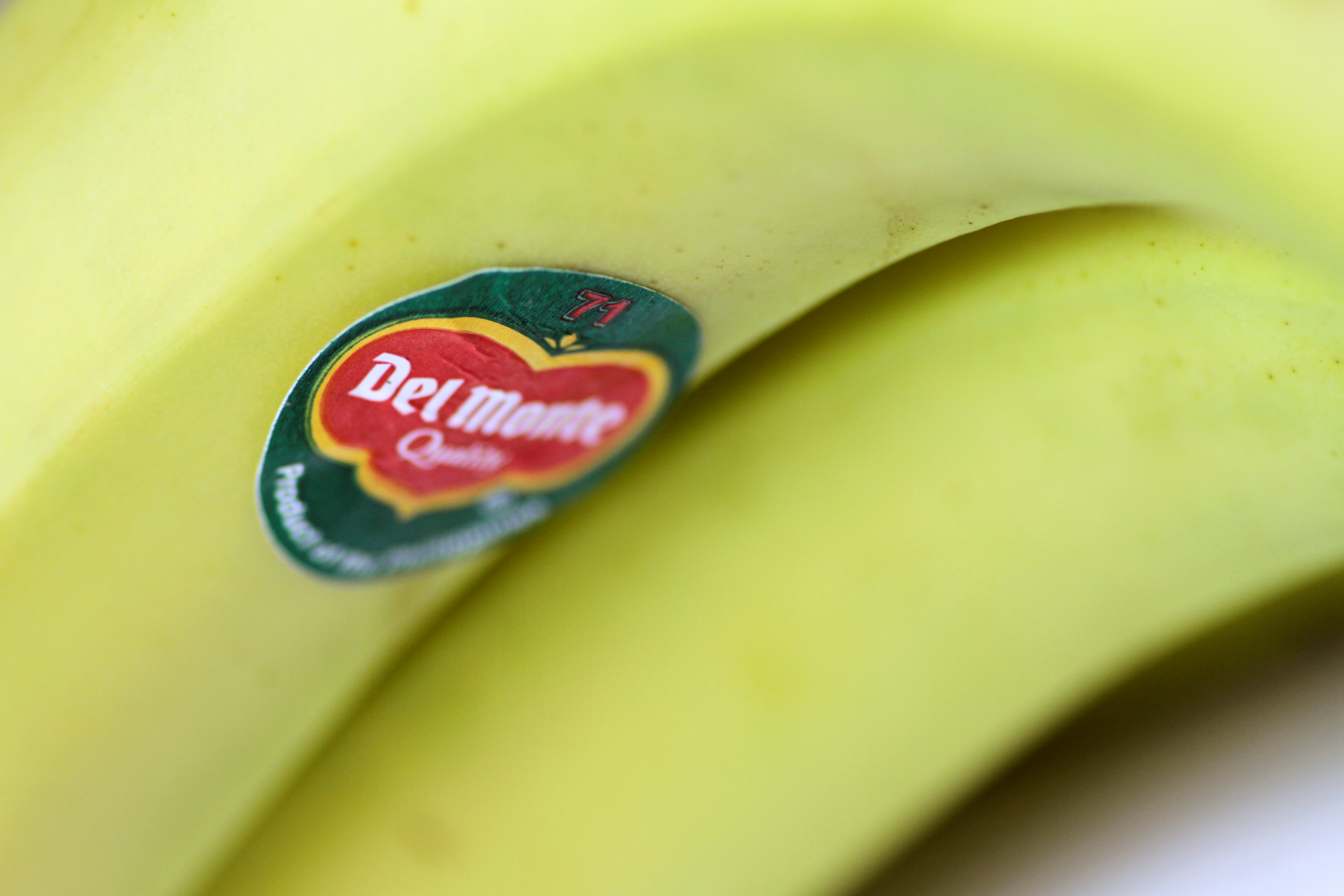 The Del Monte logo is seen on a banana in this illustration photo January 31, 2018.      REUTERS/Thomas White/Illustration
