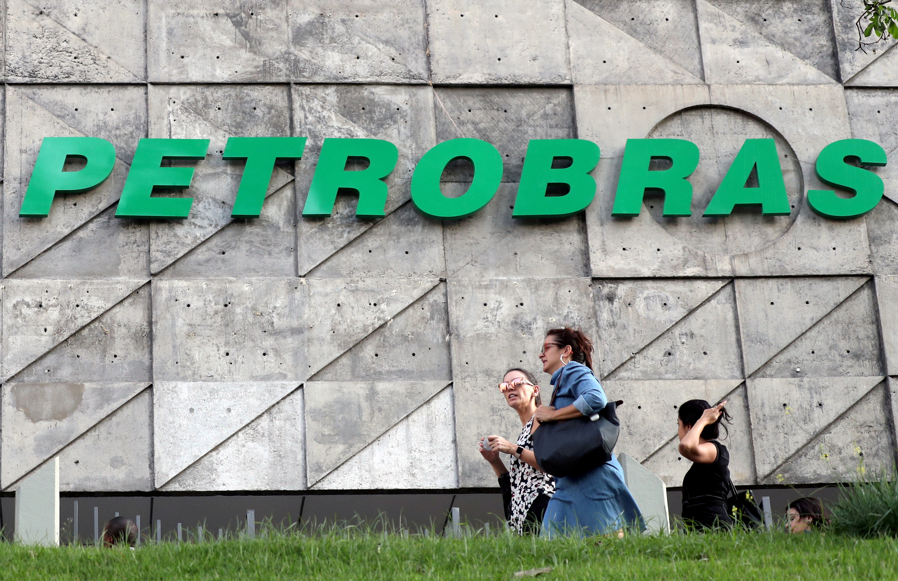 People walk in front of the Brazil's state-run Petrobras oil company headquarters in Rio de Janeiro, Brazil, October 16, 2019. Picture taken October 16, 2019. REUTERS/Sergio Moraes