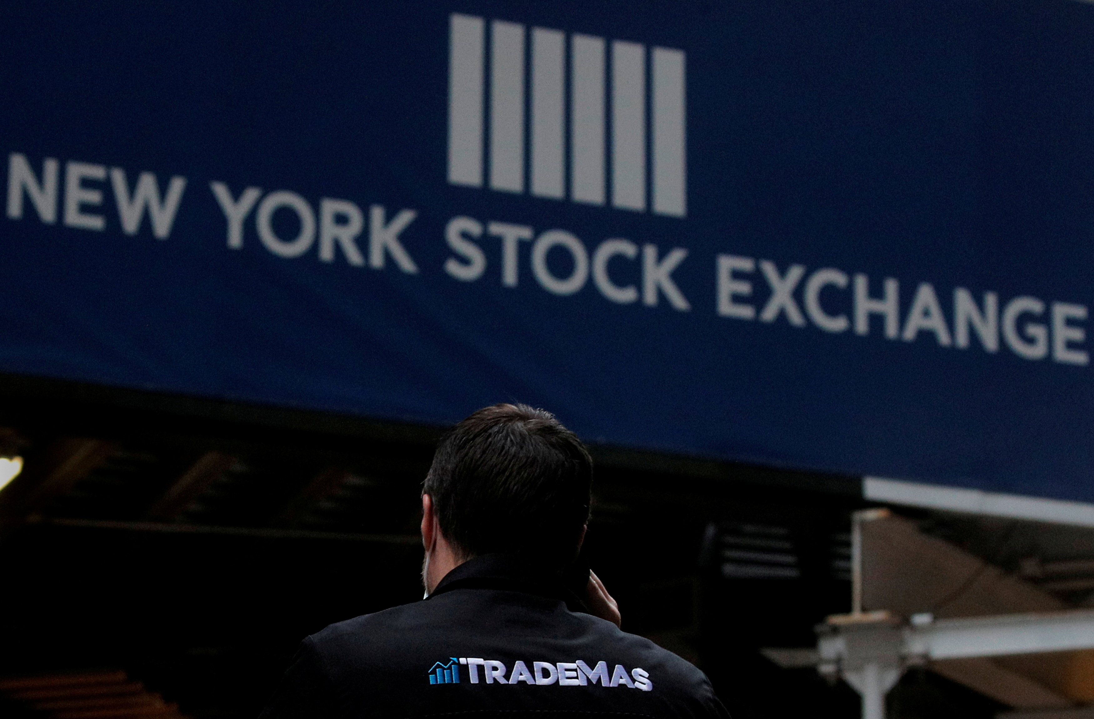 A trader talks on his phone on Wall St. outside the New York Stock Exchange (NYSE) in New York, U.S., January 15, 2021. REUTERS/Brendan McDermid