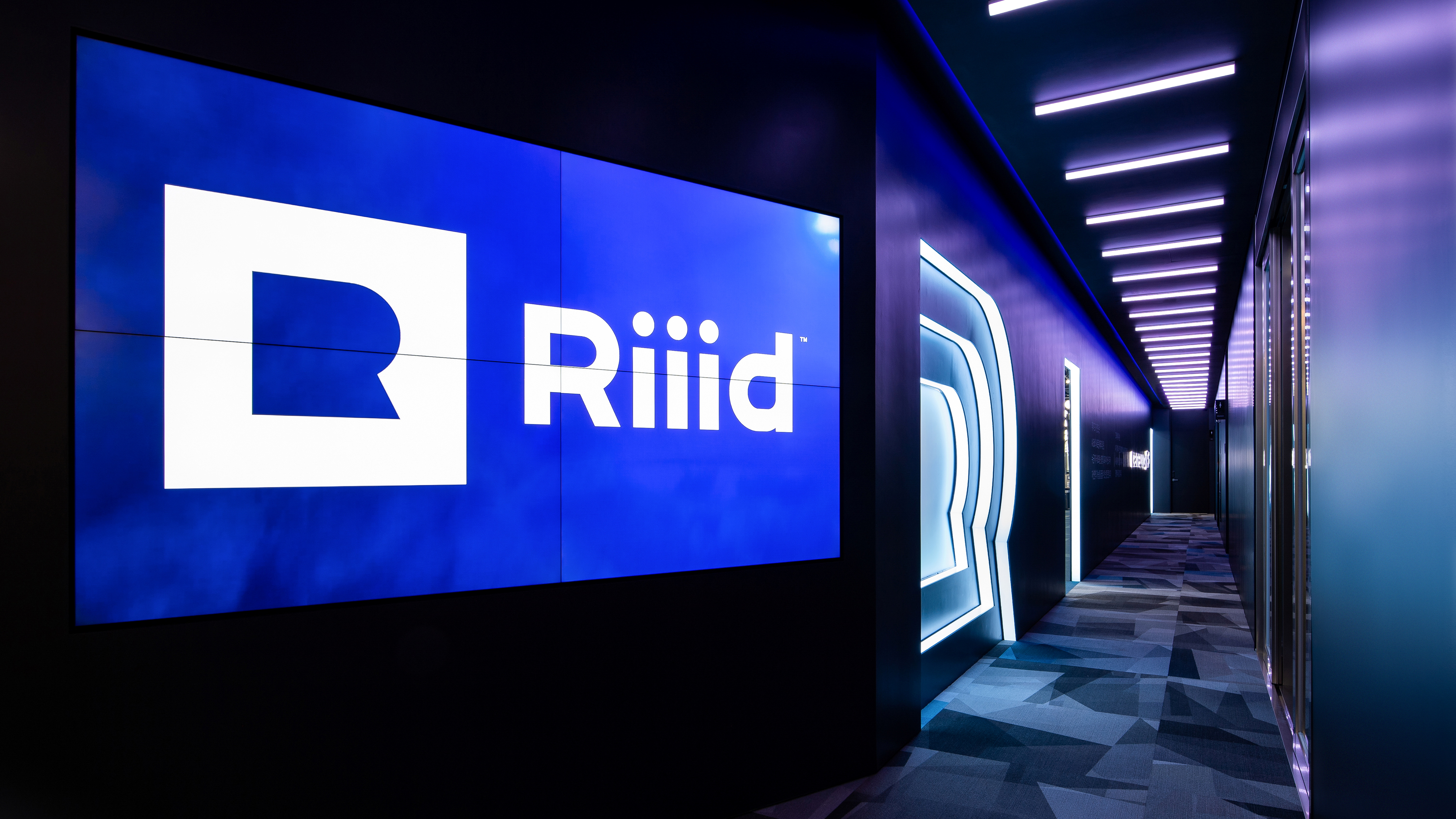 Logo of South Korean AI education technology startup Riiid is displayed in the hallway of the company's headquarters in Seoul, South Korea in this undated February 2021 handout photo. Riiid/Handout via REUTERS