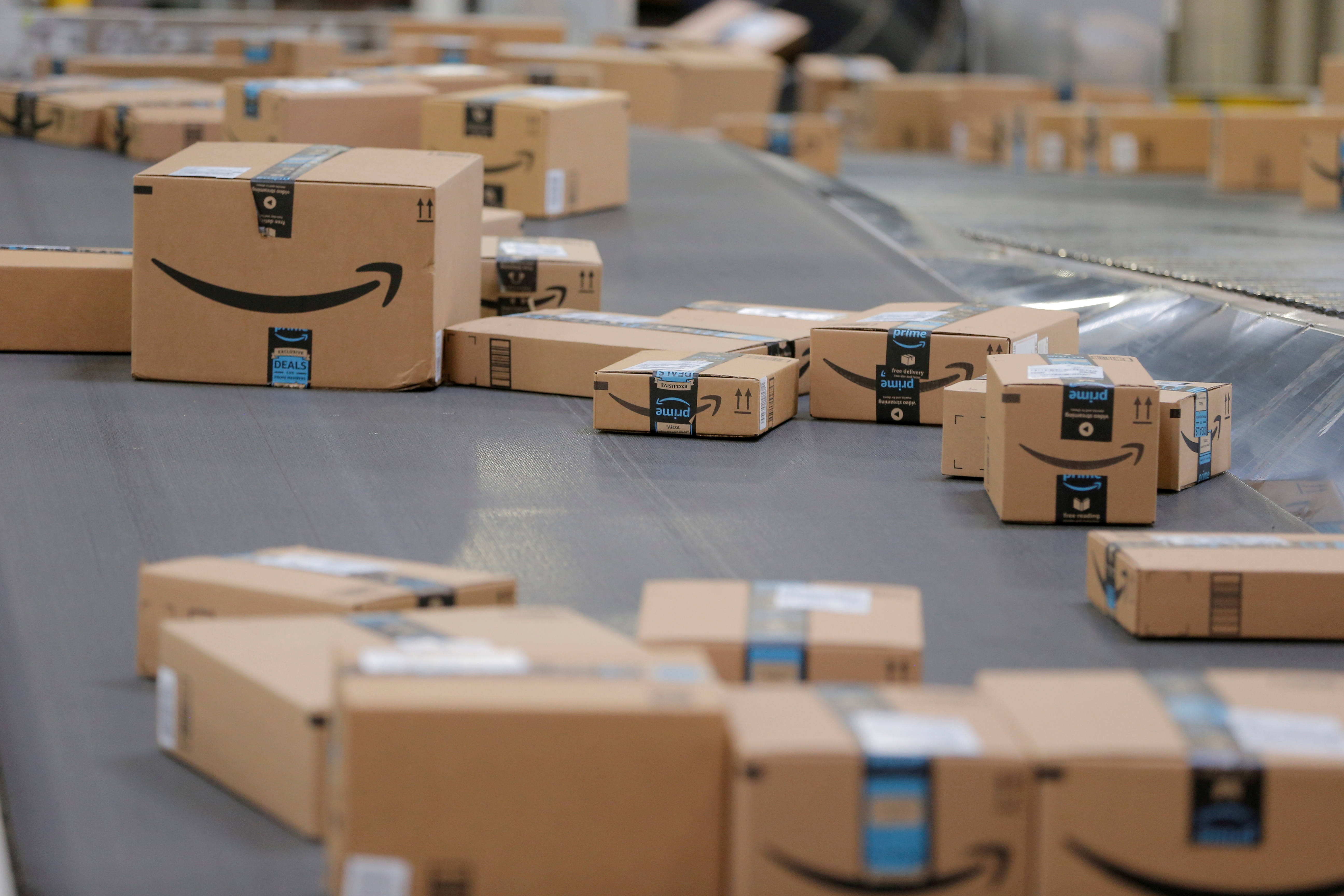 Packages emblazoned with Amazon logos travel along a conveyor belt inside of an Amazon fulfillment center in Robbinsville, New Jersey, U.S., November 27, 2017.  REUTERS/Lucas Jackson