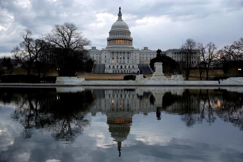 Clouds pass over the U.S. Capitol in Washington, U.S., January 22, 2018. REUTERS/Joshua Roberts