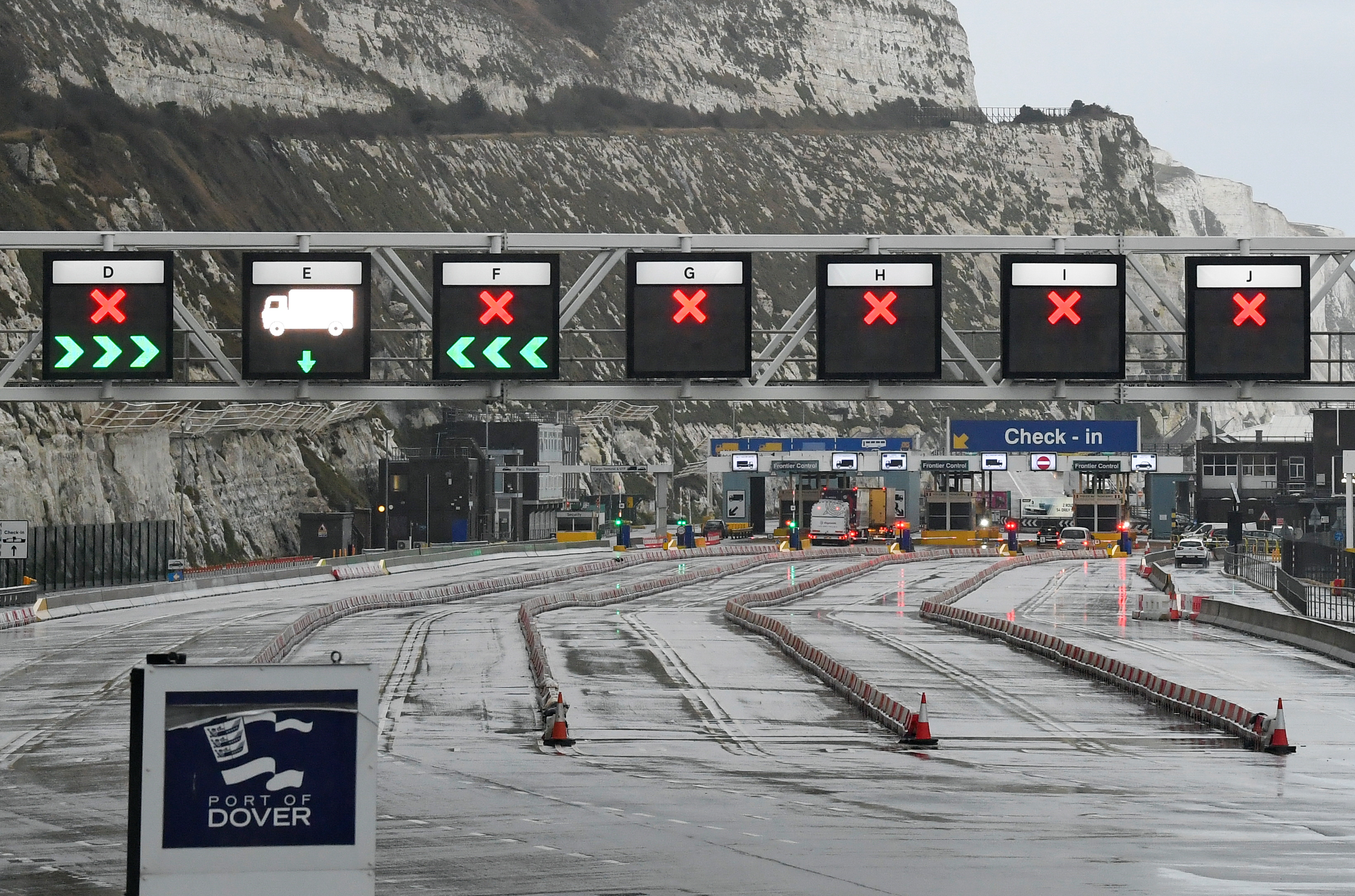 Vehicles enter the Port of Dover, following the end of the Brexit transition period, in Dover, Britain, January 4, 2021. REUTERS/Toby Melville/Files