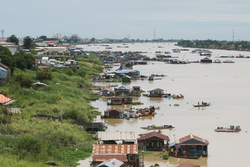 Floating houses are seen on the Tonle Sap River in Prek Pnov district, Phnom Penh, Cambodia, June 12, 2021. REUTERS/Cindy Liu
