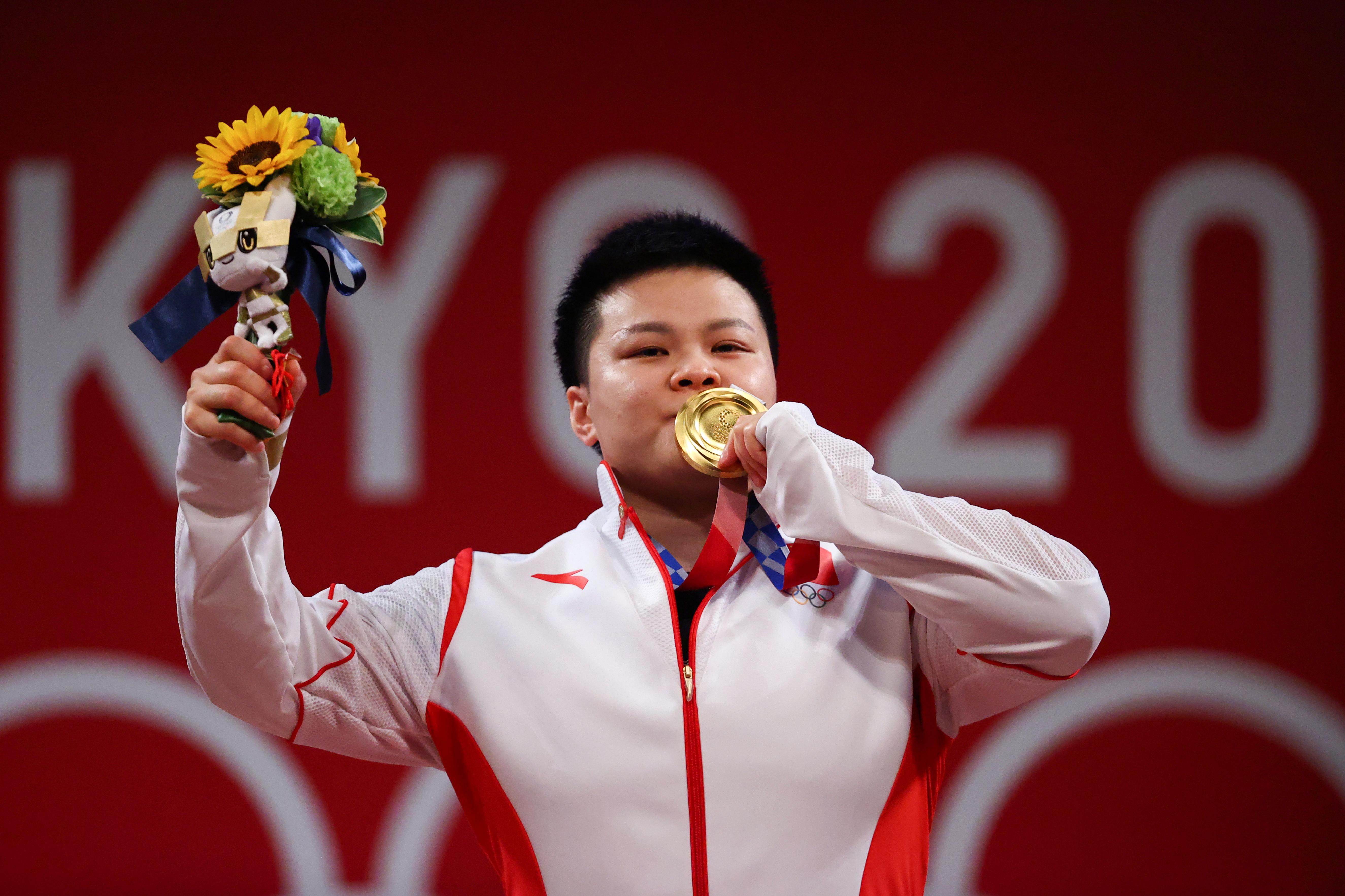 Tokyo 2020 Olympics - Weightlifting - Women's 87kg - Medal Ceremony - Tokyo International Forum, Tokyo, Japan - August 2, 2021. Gold medalist Wang Zhouyu of China reacts. REUTERS/Edgard Garrido