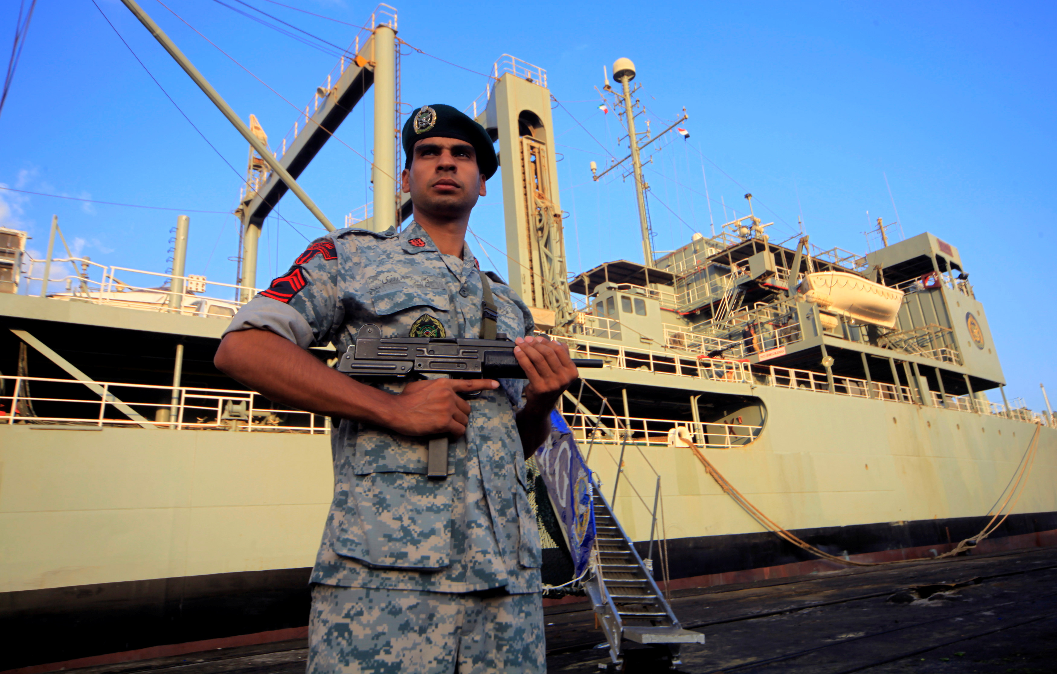 An Iranian soldier stands guard near Iranian Navy helicopter carrier Kharg at Port Sudan at the Red Sea State, October 31, 2012. REUTERS/ Mohamed Nureldin Abdallah/File Photo