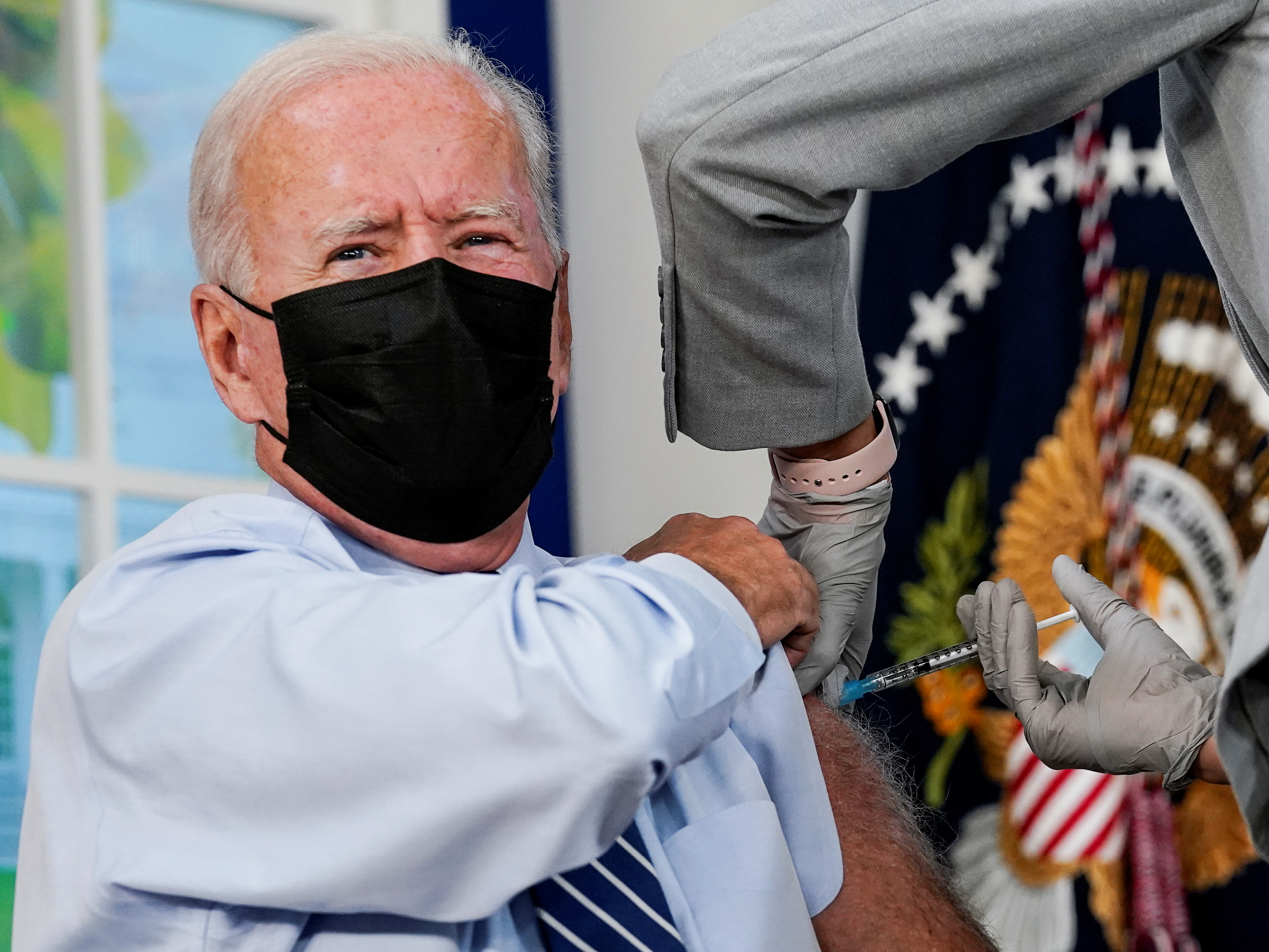 U.S. President Joe Biden receives his coronavirus disease (COVID-19) booster vaccination in the Eisenhower Executive Office Building's South Court Auditorium at the White House in Washington, U.S., September 27, 2021. REUTERS/Kevin Lamarque