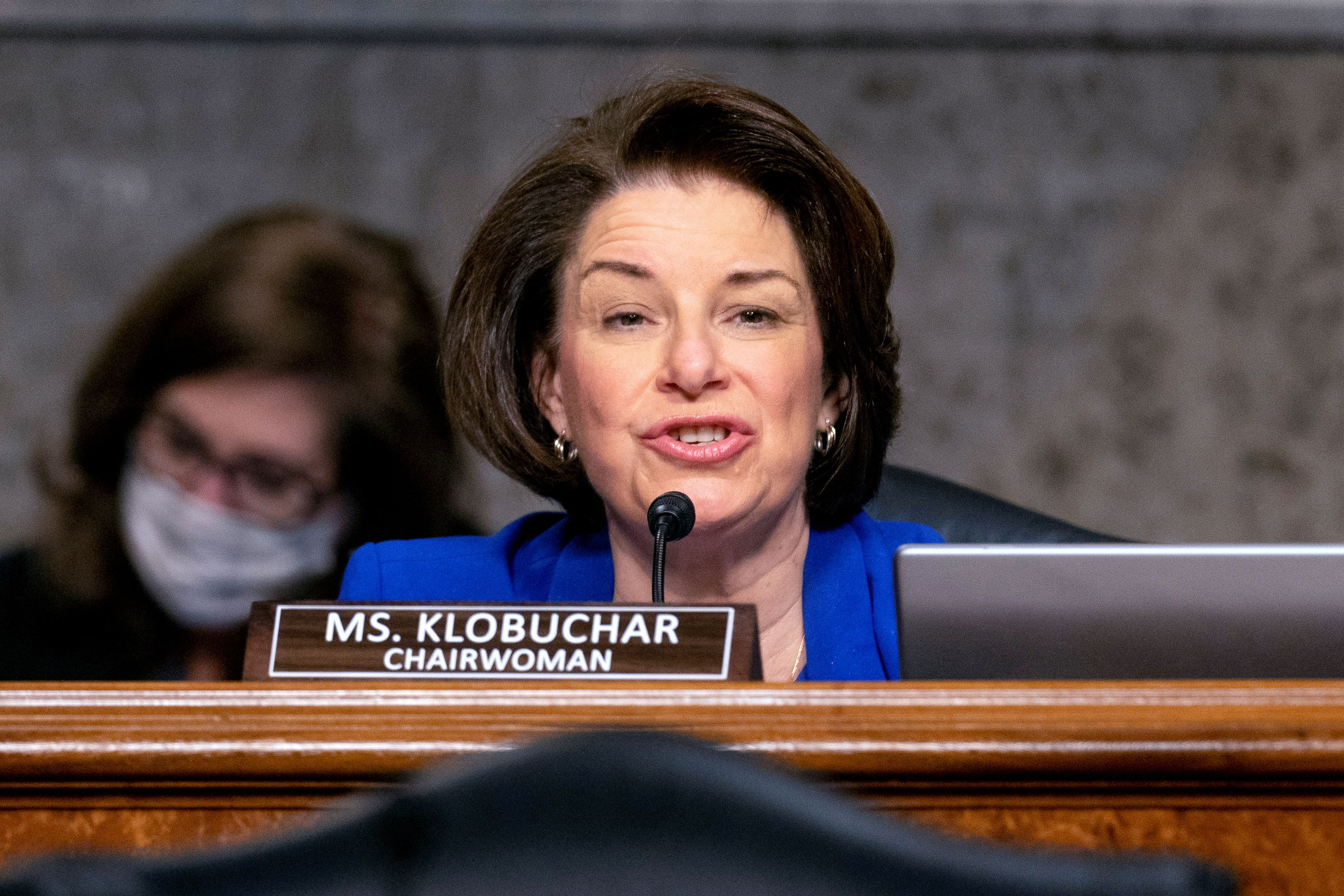 PHChairwoman Amy Klobuchar, D-Minn., speaks at the start of a Senate Homeland Security and Governmental Affairs & Senate Rules and Administration joint hearing on Capitol Hill, Washington, U.S., February 23, 2021, to examine the January 6th attack on the Capitol. Andrew Harnik/Pool via REUTERS