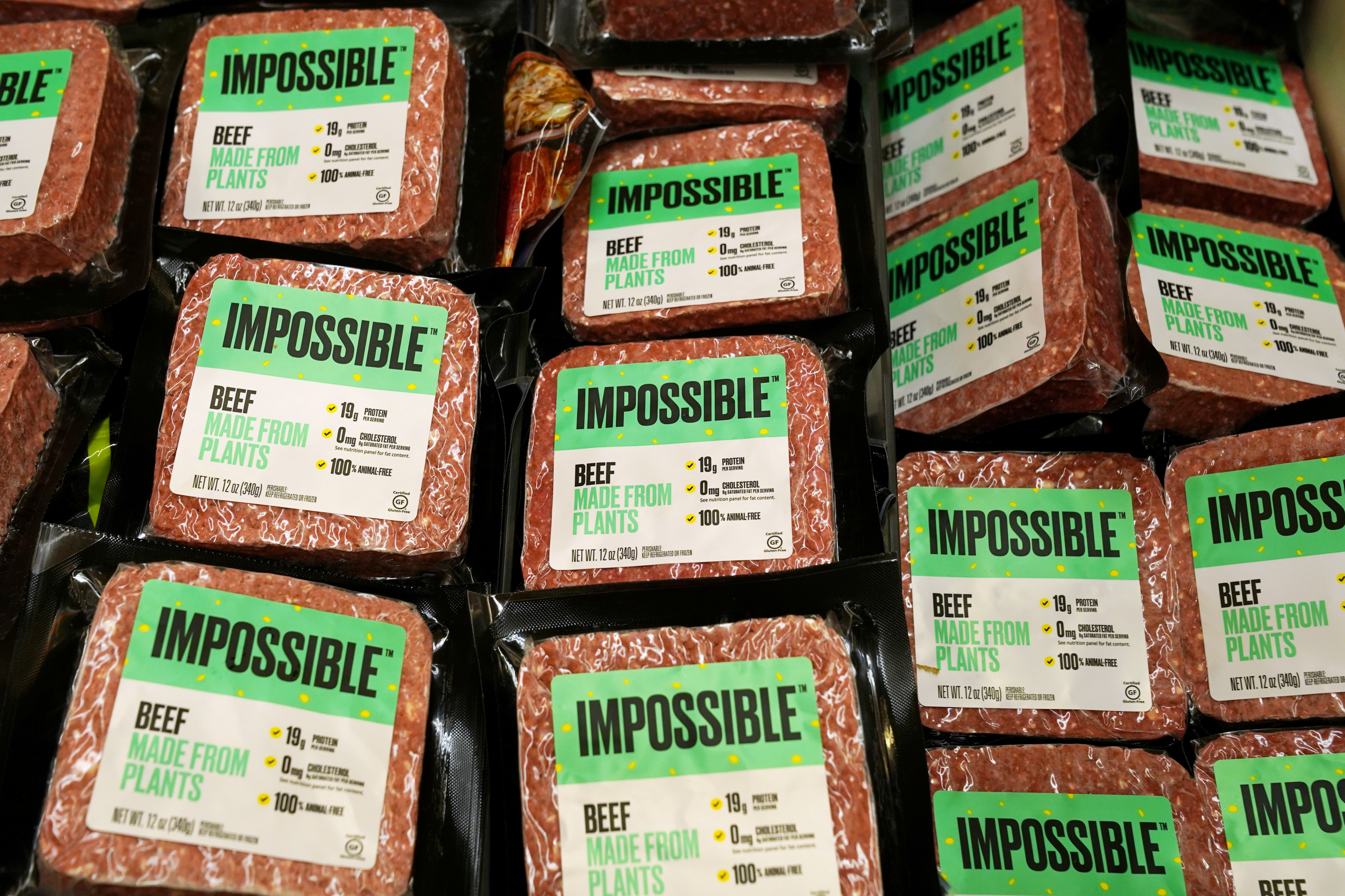 Impossible Foods plant-based beef products are seen inside a refrigerator at the meat section of a chain supermarket in Hong Kong, China, October 20, 2020. REUTERS/Lam Yik/File Photo