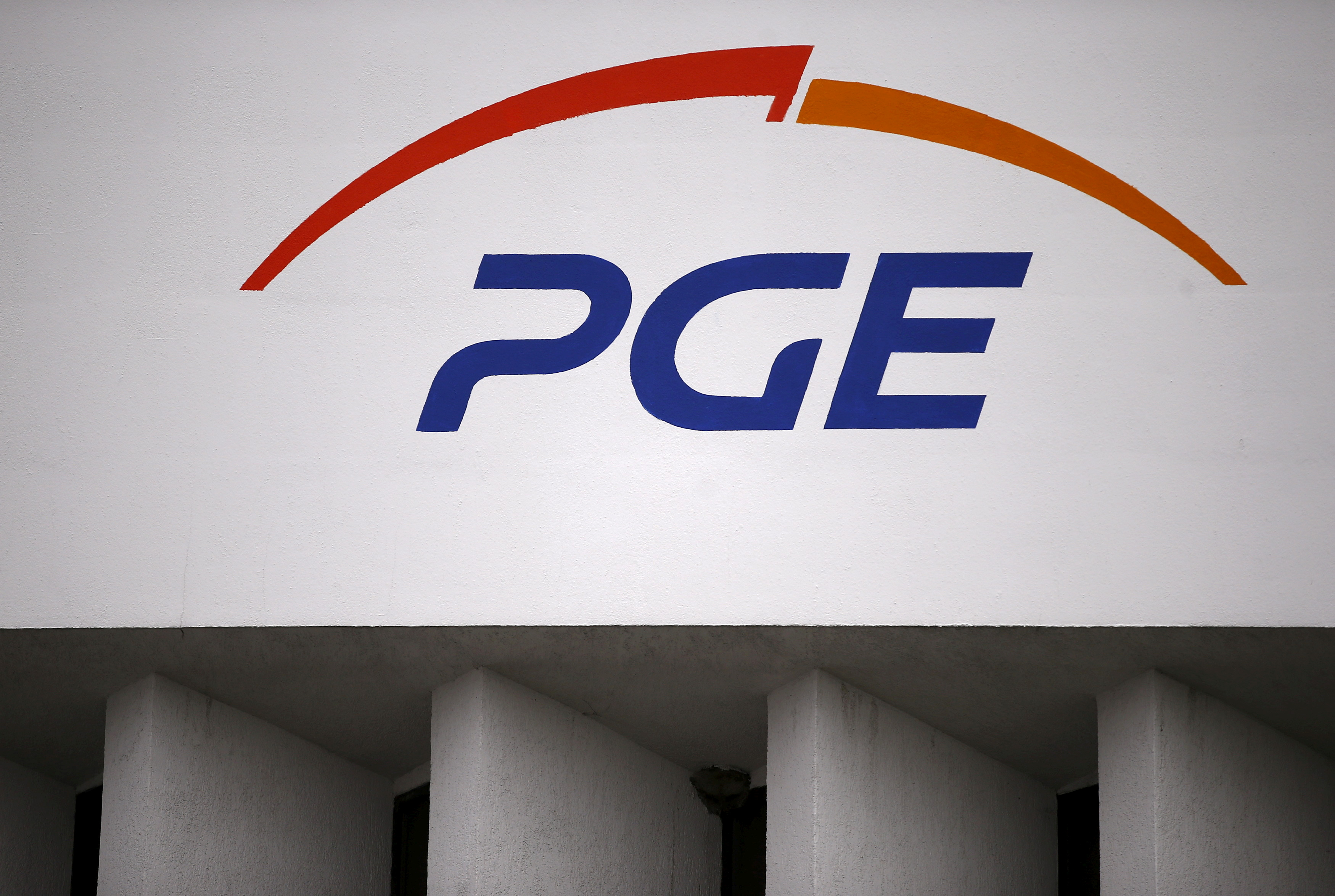 The logo of PGE Group is seen on PGE Gornictwo i Energetyka Konwencjonalna S.A. (Mining and Conventional Energy) building at the Belchatow Coal Mine, the biggest opencast mine of brown coal in Poland, near Belchatow, December 2 , 2015. REUTERS/Kacper Pempel