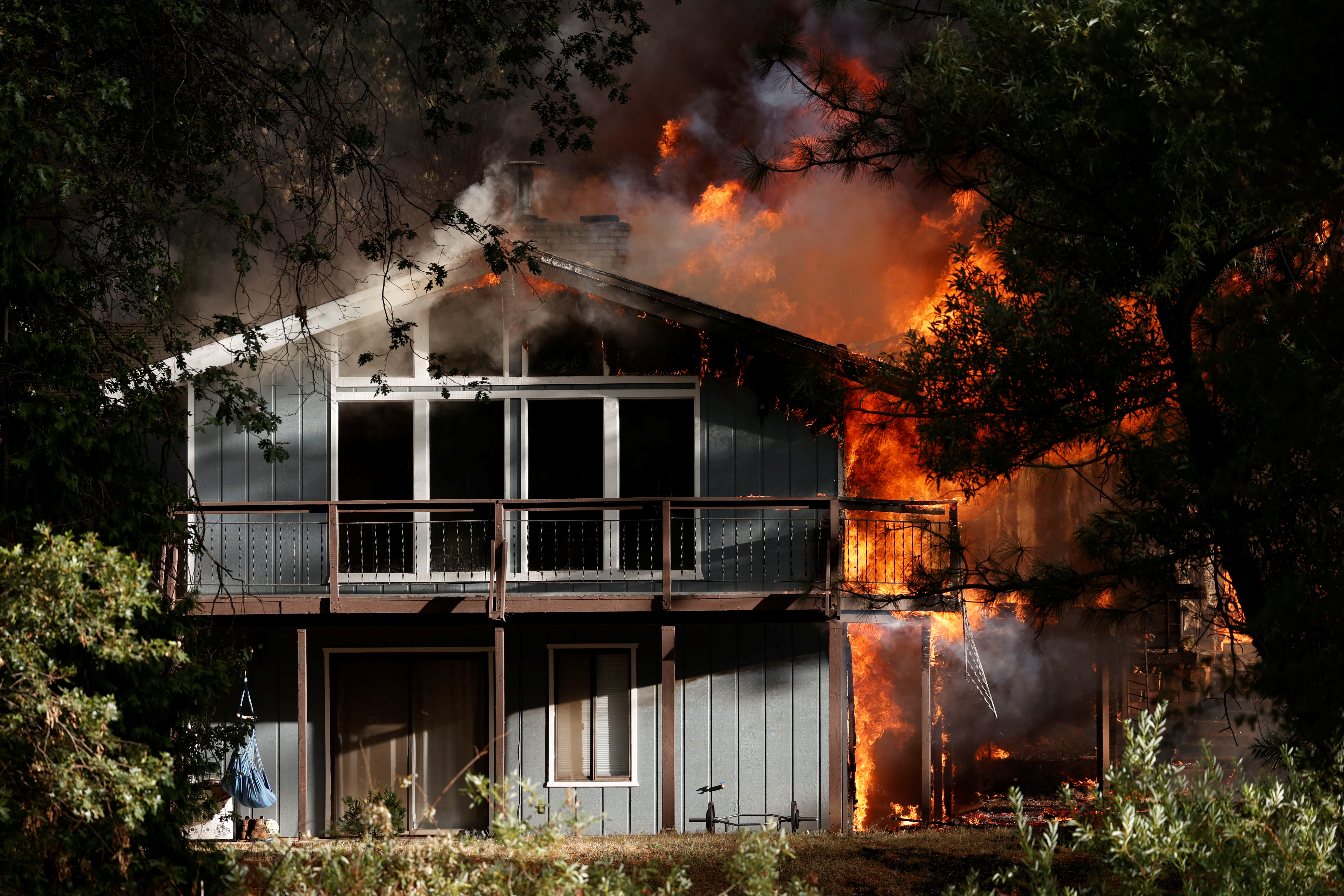 A home is consumed by flames in the River Fire, a wildfire burning near Grass Valley, California, U.S., August 4, 2021. REUTERS/Fred Greaves