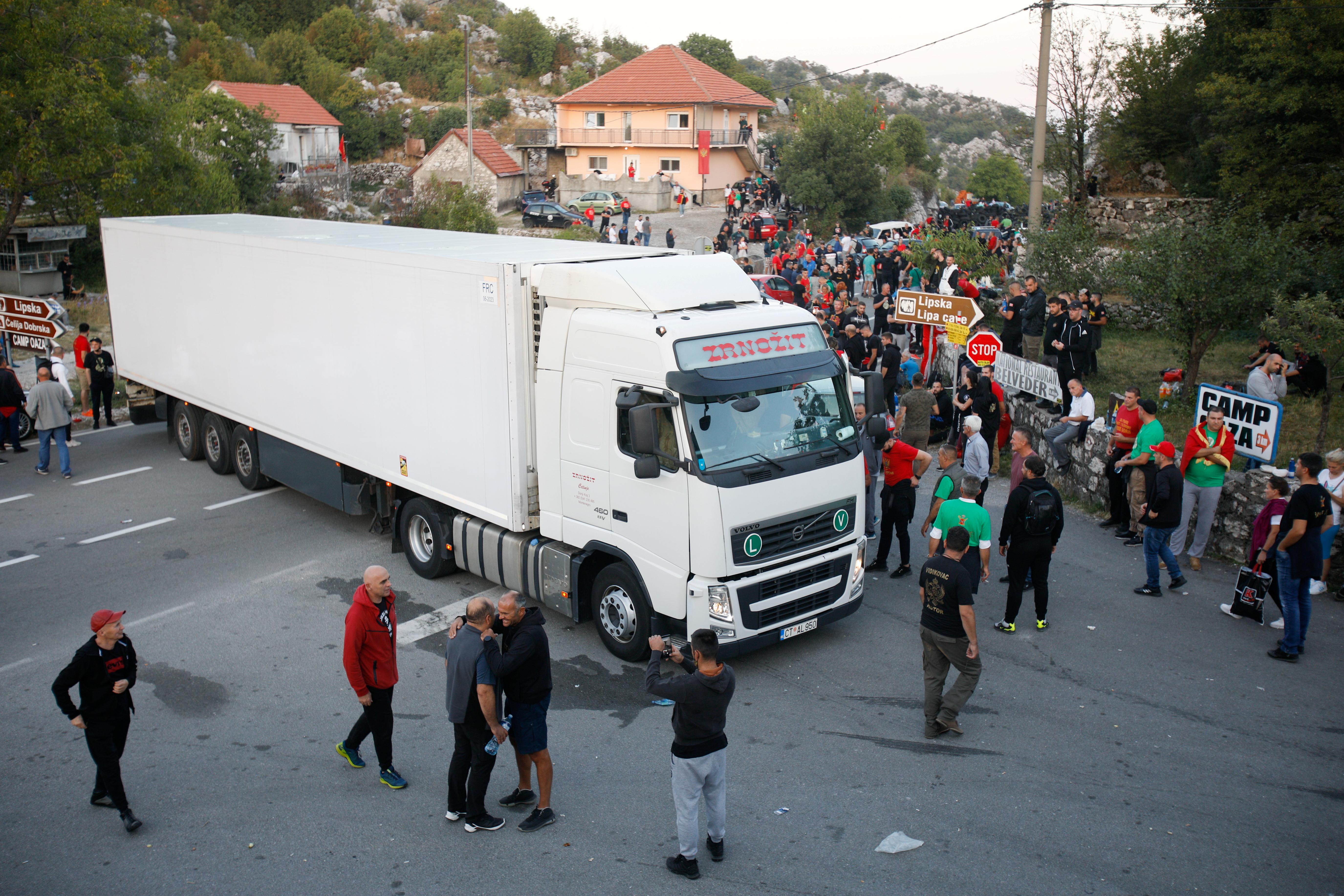 A truck arrives at a blockage of demonstrators during a protest against the enthronement of Bishop Joanikije in Cetinje, Montenegro, September 4, 2021. REUTERS/Stevo Vasiljevic